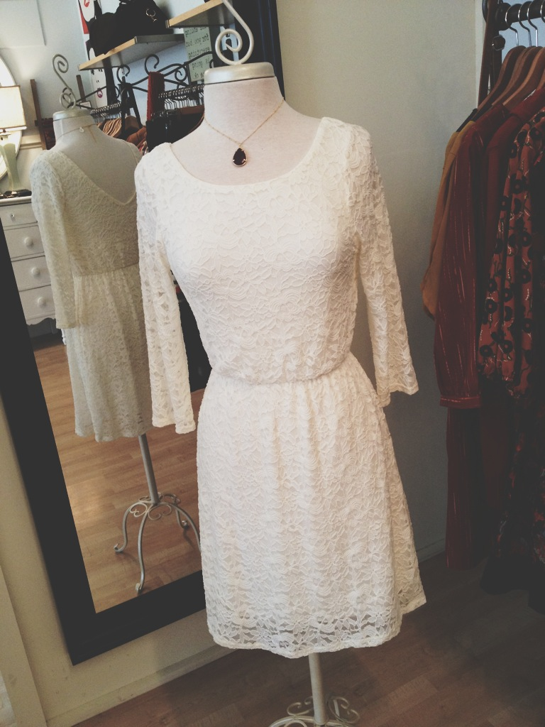 White lacy dress with V-back neck line. Perfect for a holiday party or for a bride to wear at the rehearsal dinner.