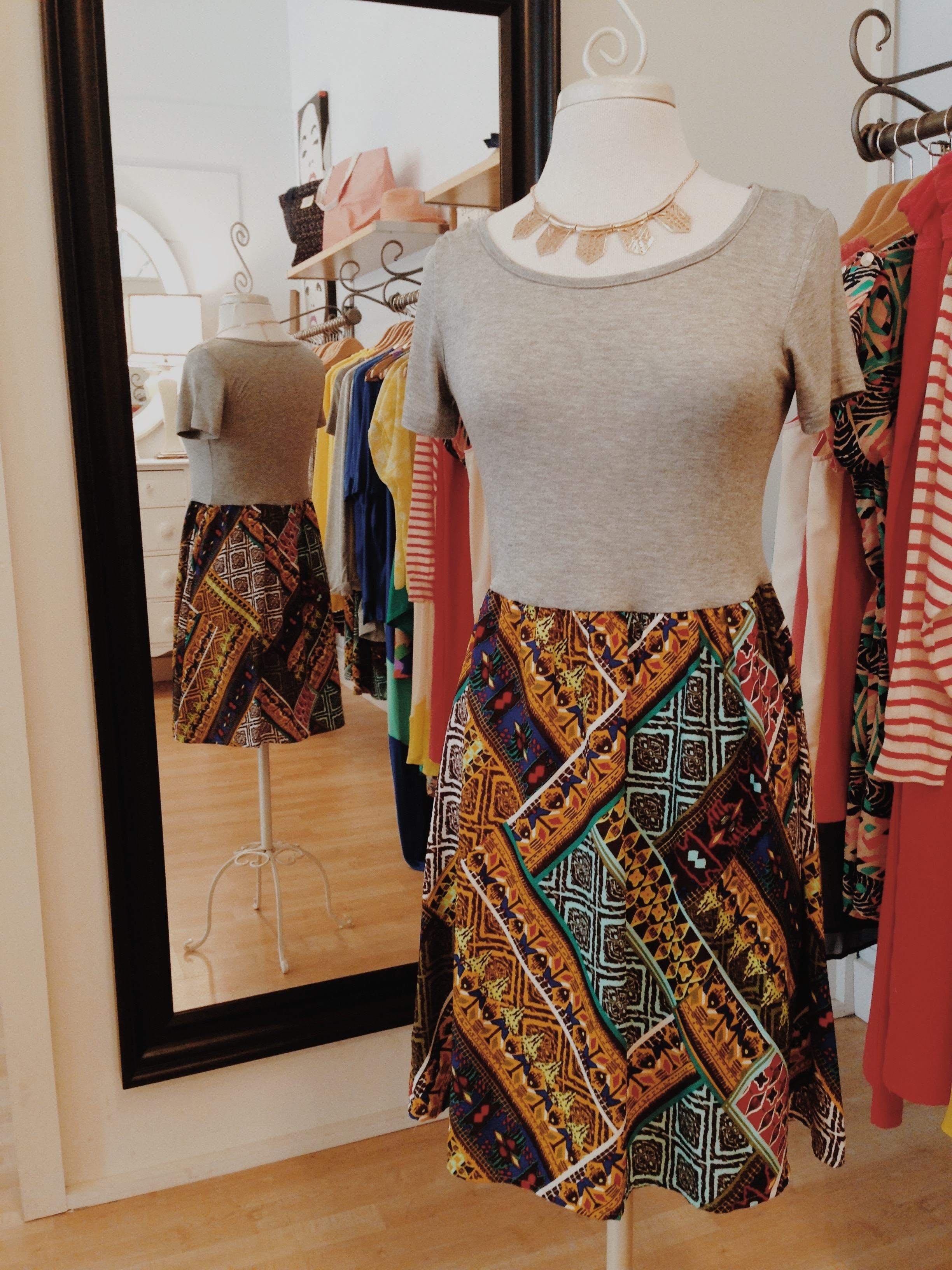 Print dress. It would look great with a pair of riding boots!