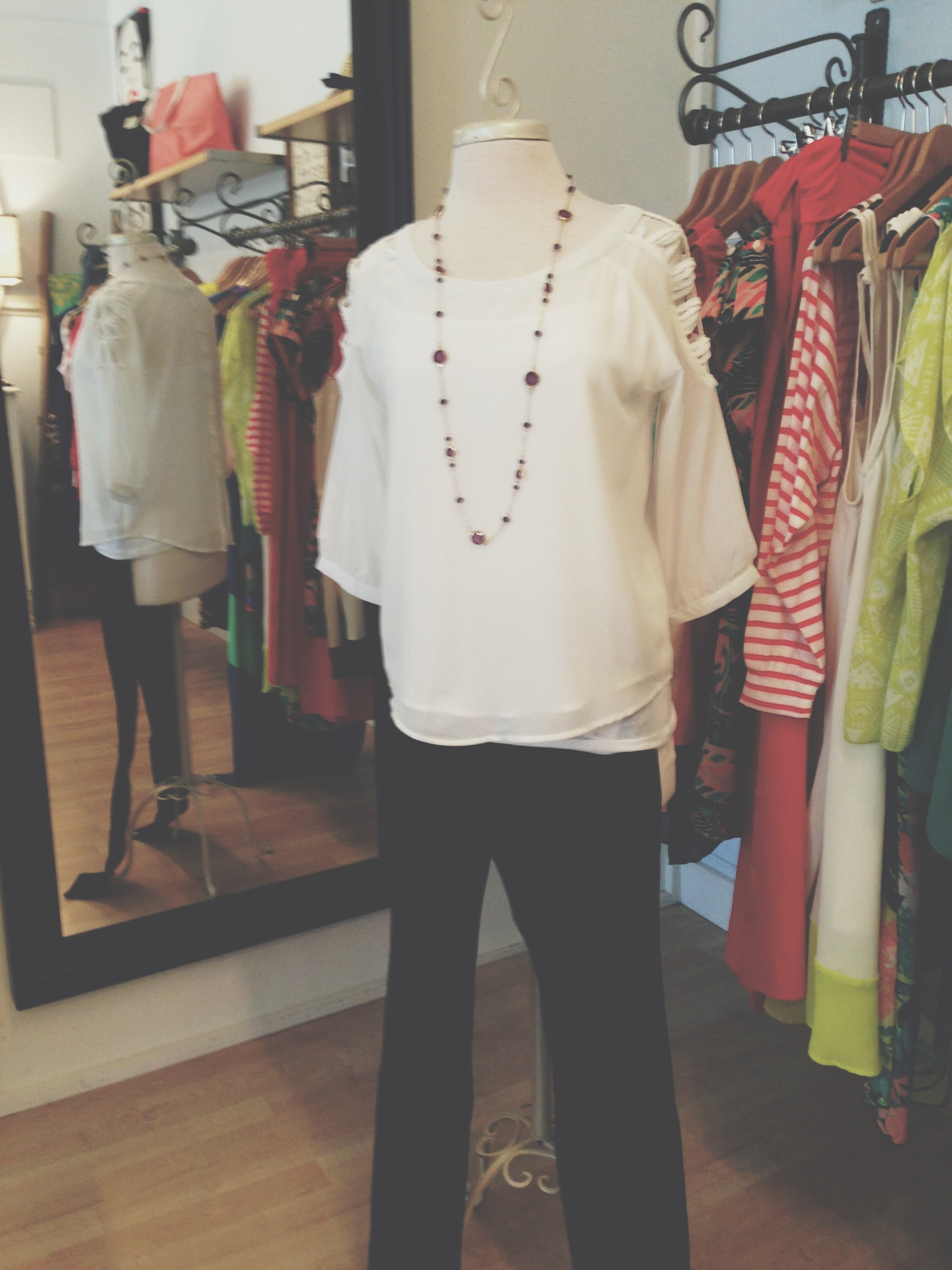 White cut out blouse layered with necklace, and worn with Vigoss Studio denim.