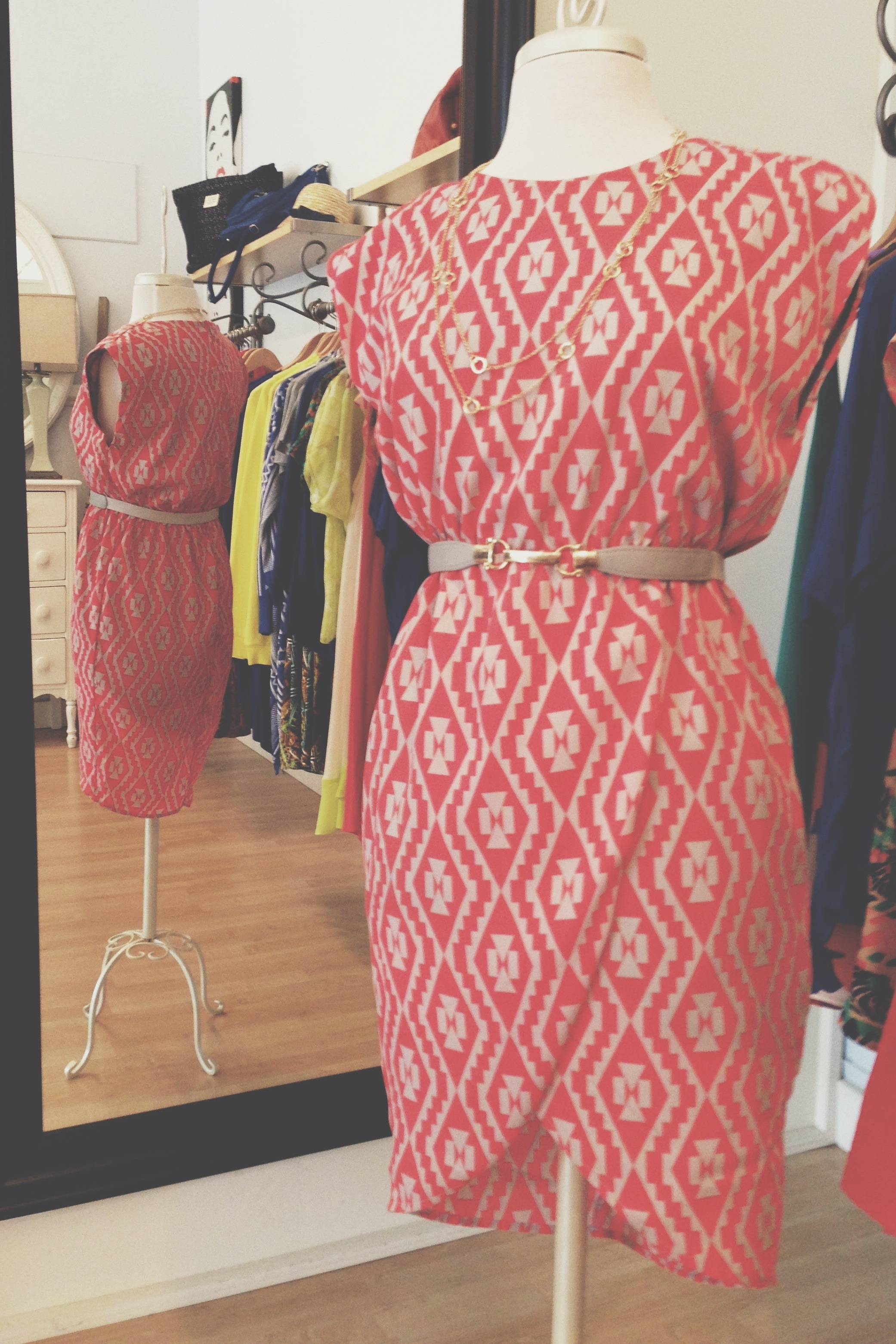 Red + Tan print dress belted with a necklace.