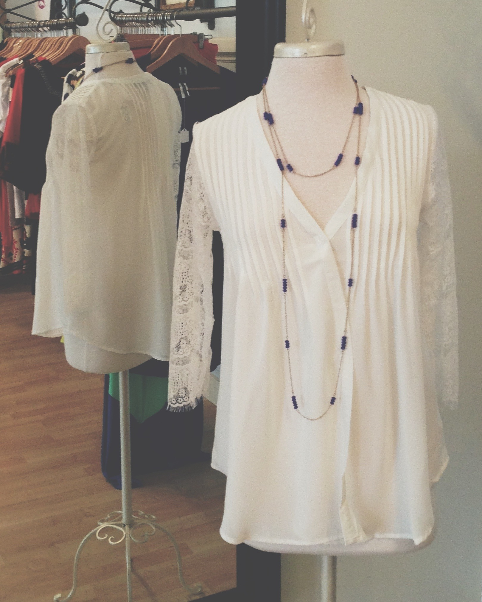 Sheer top and lace 3/4 length sleeves, with pretty details on the front.