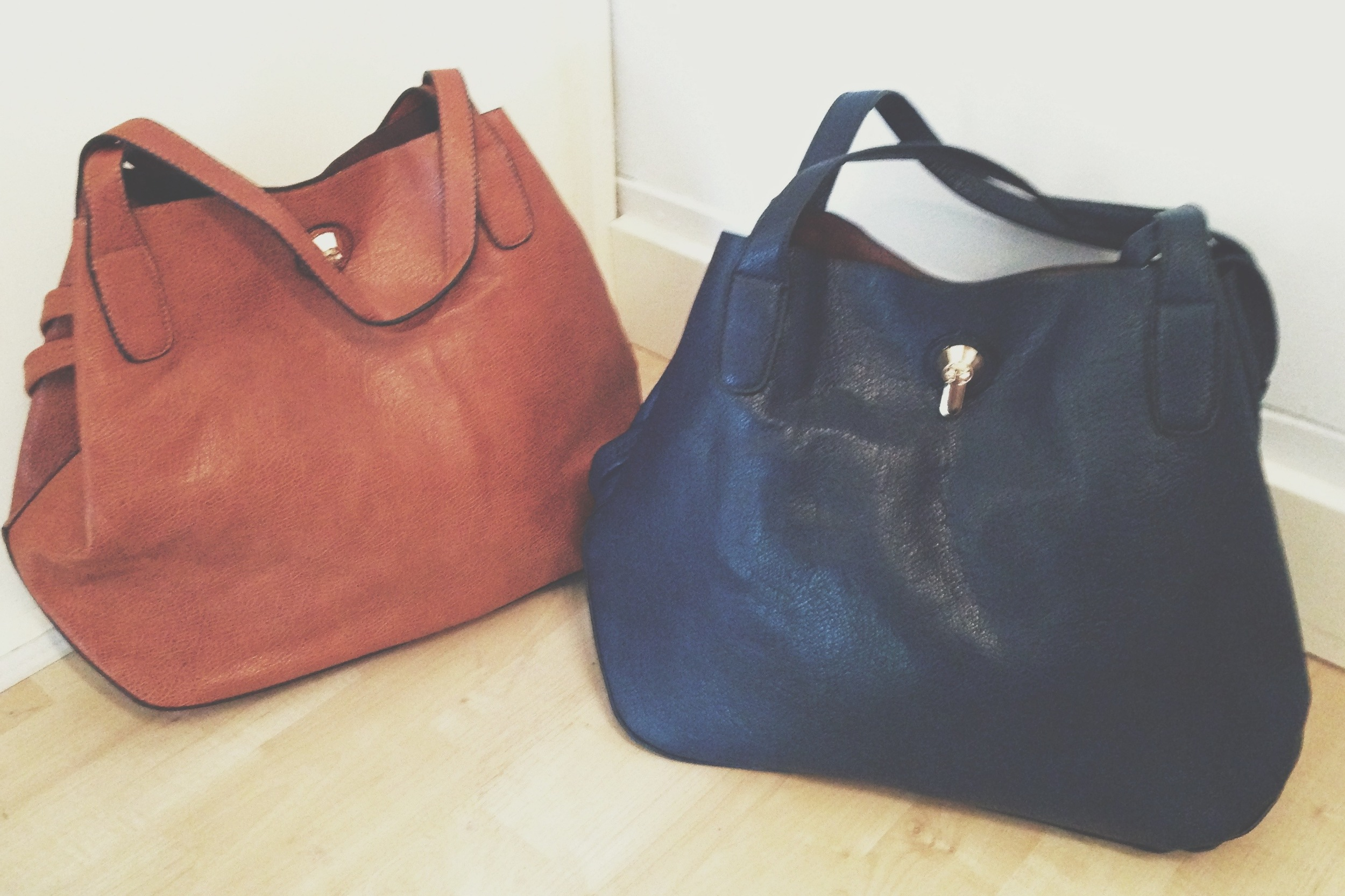 These purses are adorable, and they come with cross-body strap!