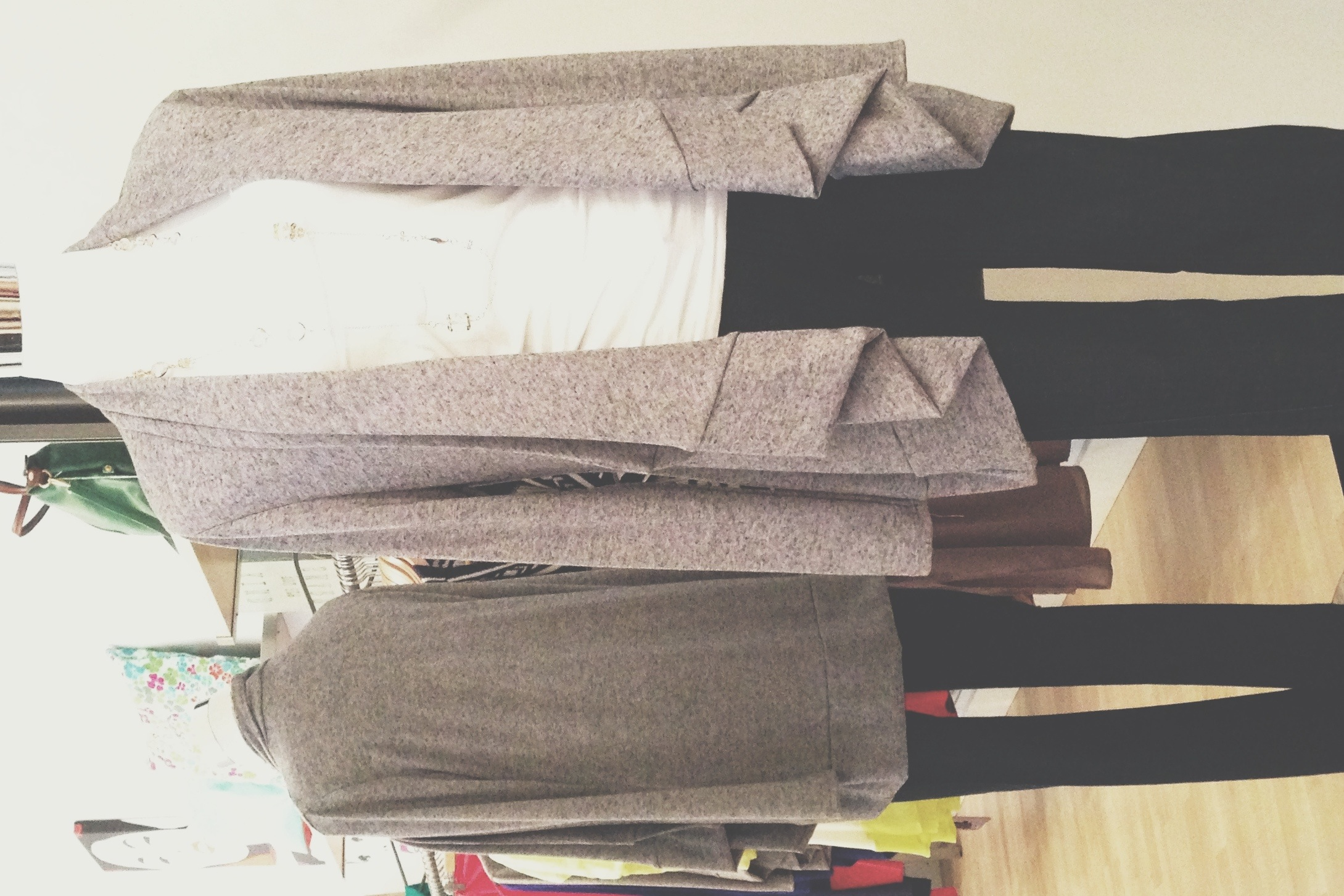 Long grey cardigan. Perfect length to cozy up on a stormy Saturday watching the game ;)