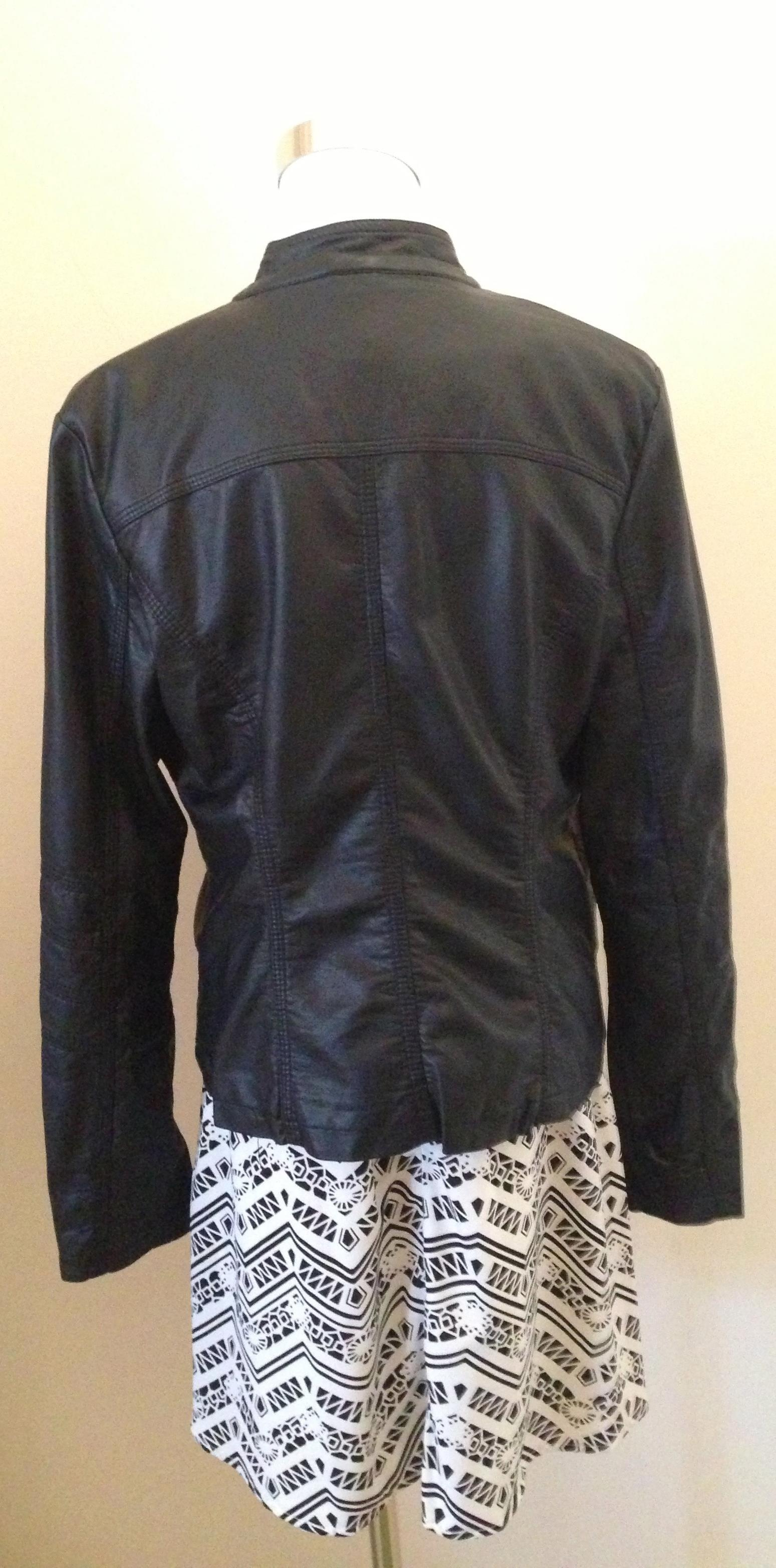 leather jacket rear view with dress.jpg