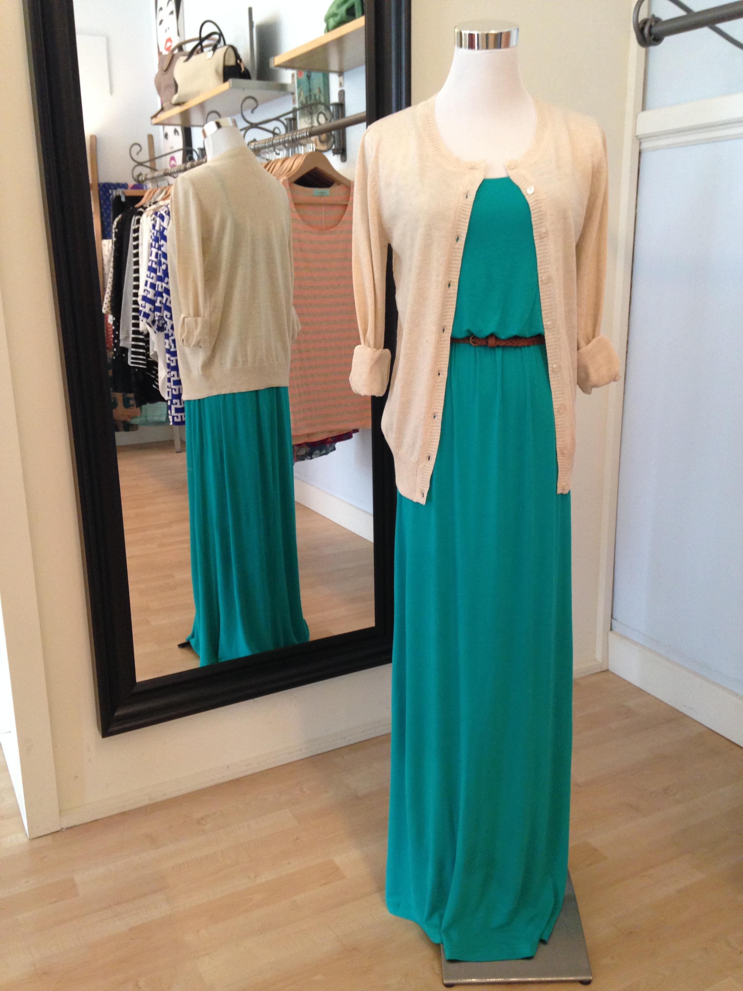 Green maxi dress with belt under an oatmeal cardigan