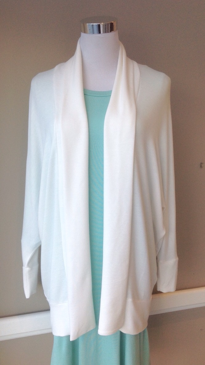 Ivory jersey knit cardigan with shawl collar and batwing sleeves, $35