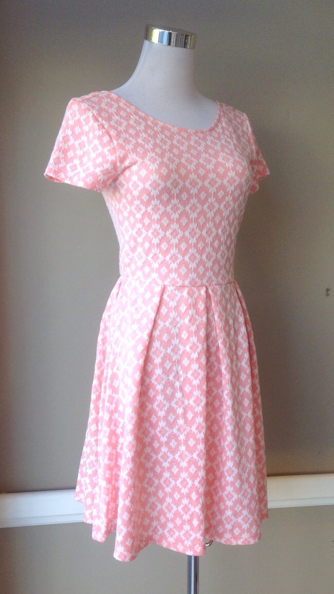 Pink and white jacquard knit dress with pleated and gathered waist, $42