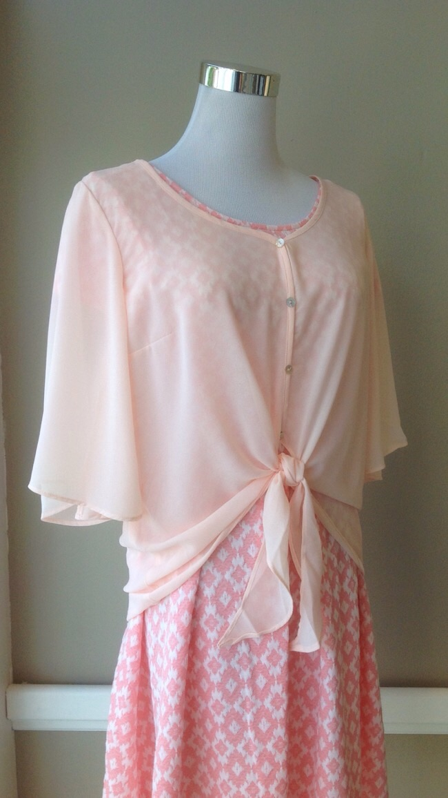 Poly chiffon tie front blouse in petal pink, $34