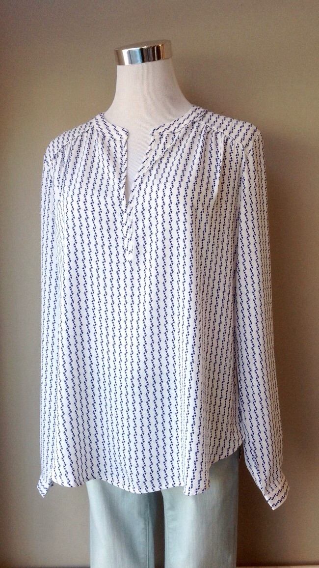 Printed blouse with front closure in white/navy, $38
