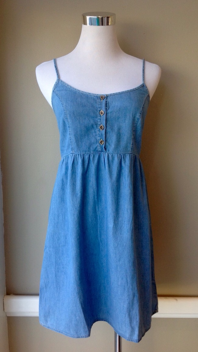 Chambray babydoll dress with front button closure and back smocking, $35