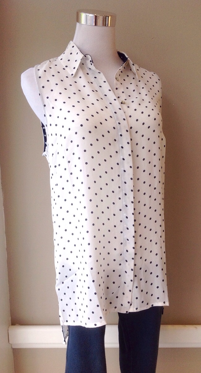 Sleeveless white and navy polka dot button-down with high-low hem, $32