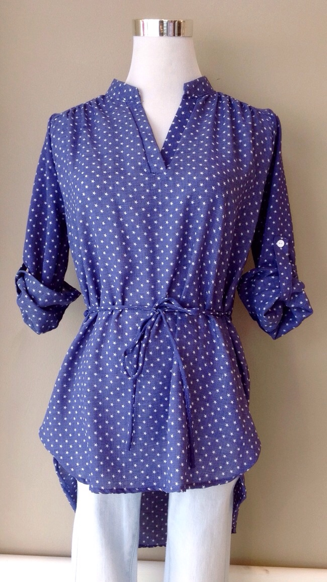 Denim blue star print blouse with self tie and high-low hem, $34