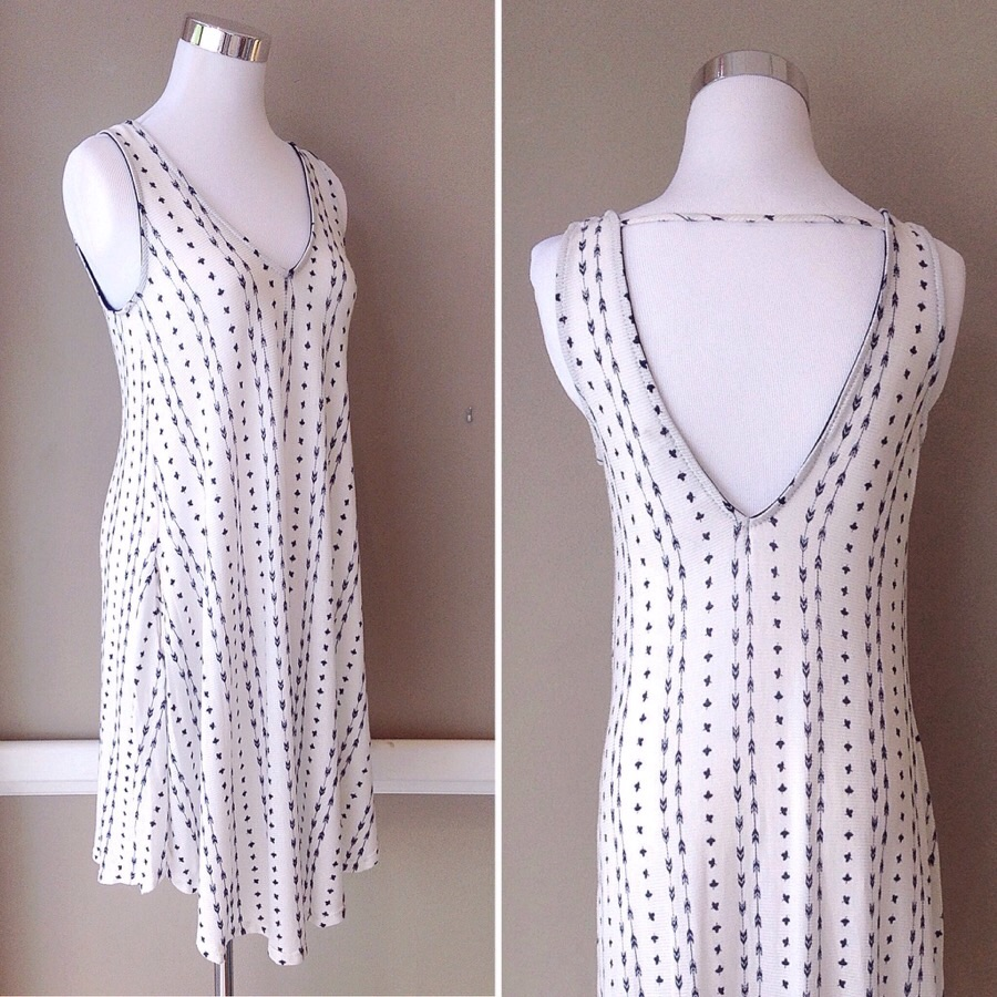 Ivory/navy pattern print trapeze dress with side pockets, $35