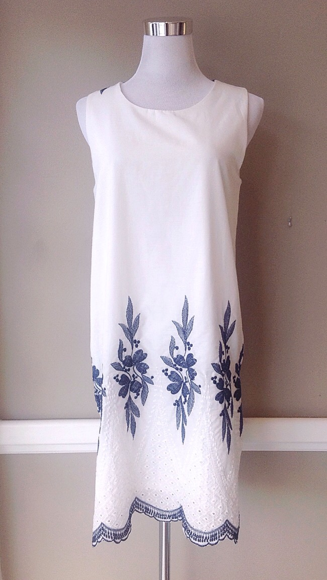 White cotton shift dress with floral embroidery, $42