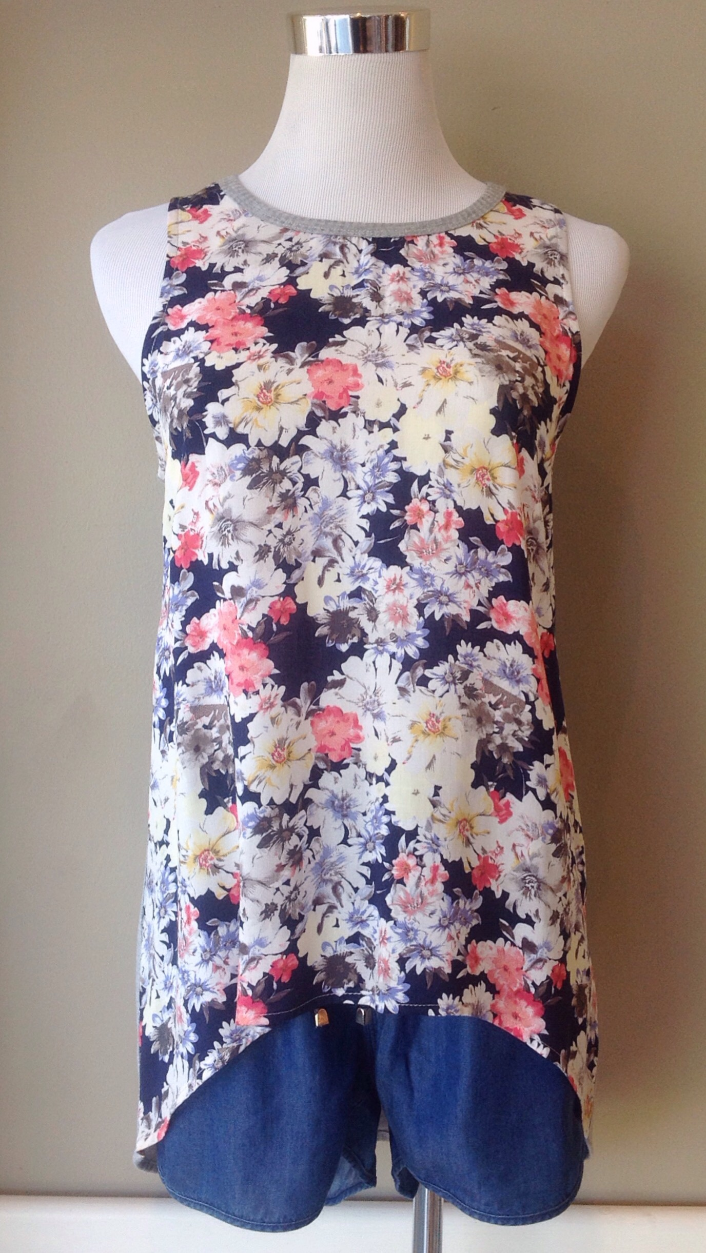 Floral tank with solid grey knit back and high-low hem, $32