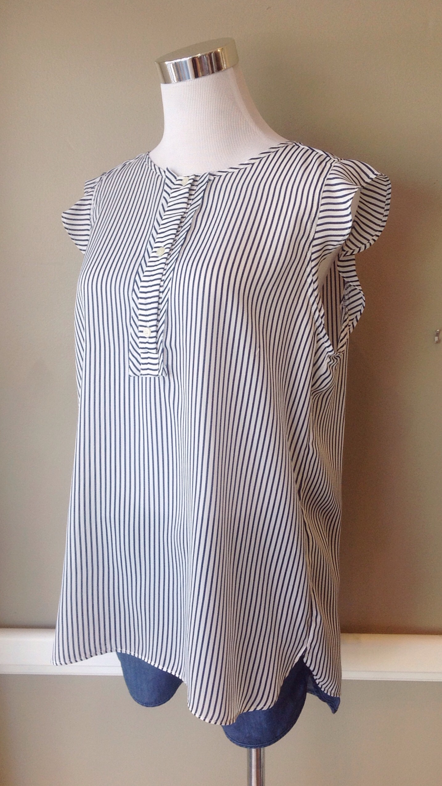 Navy and white stripe woven tank with soft ruffle cap sleeves, $34