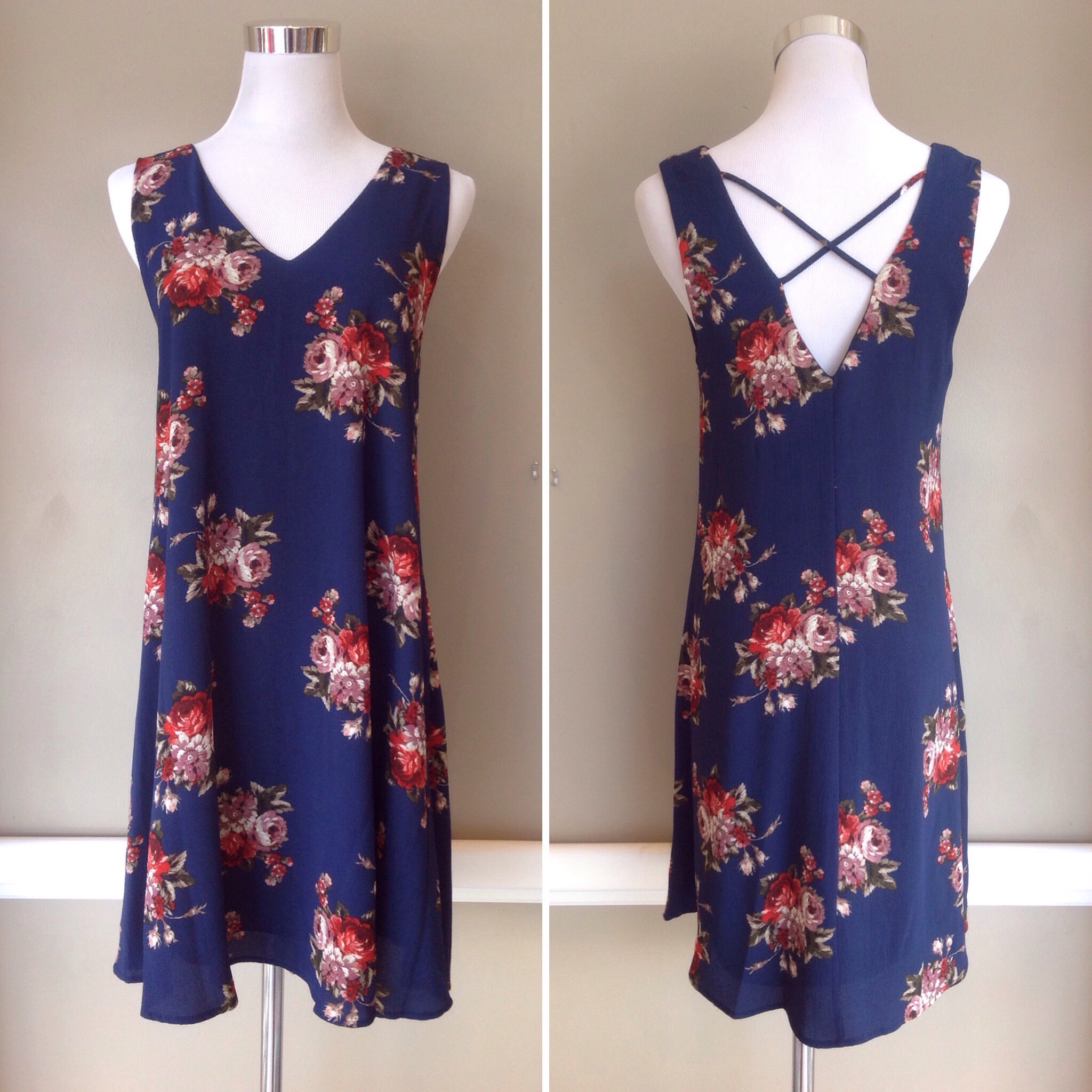 Navy floral print v neck dress with cross back, $38