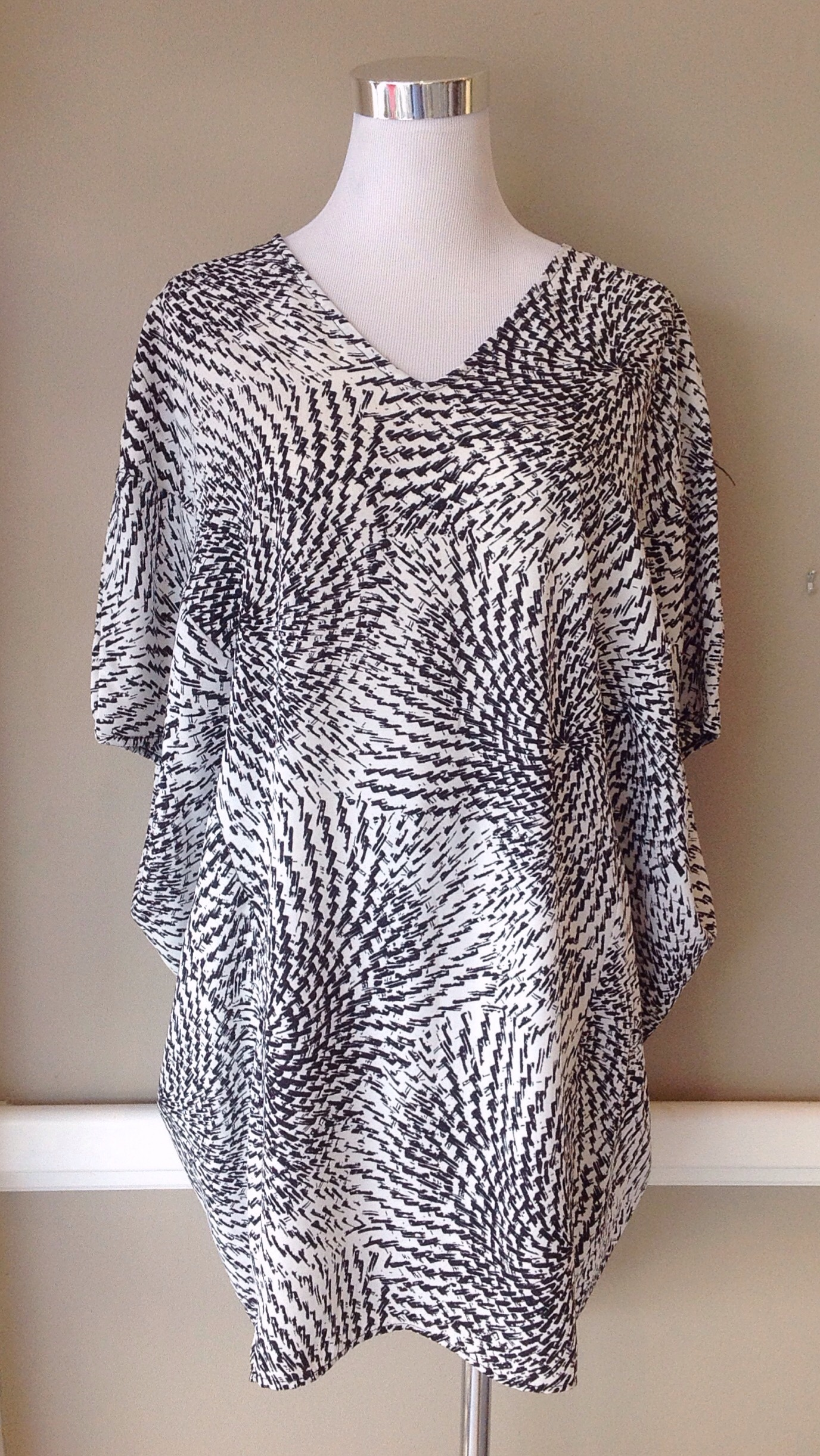 Black and white circle print tunic top, $34