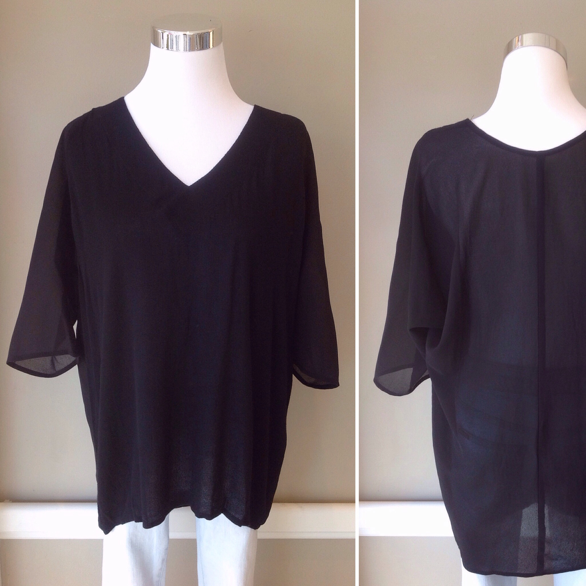 Woven black blouse with sheer back and high-low hem, $34