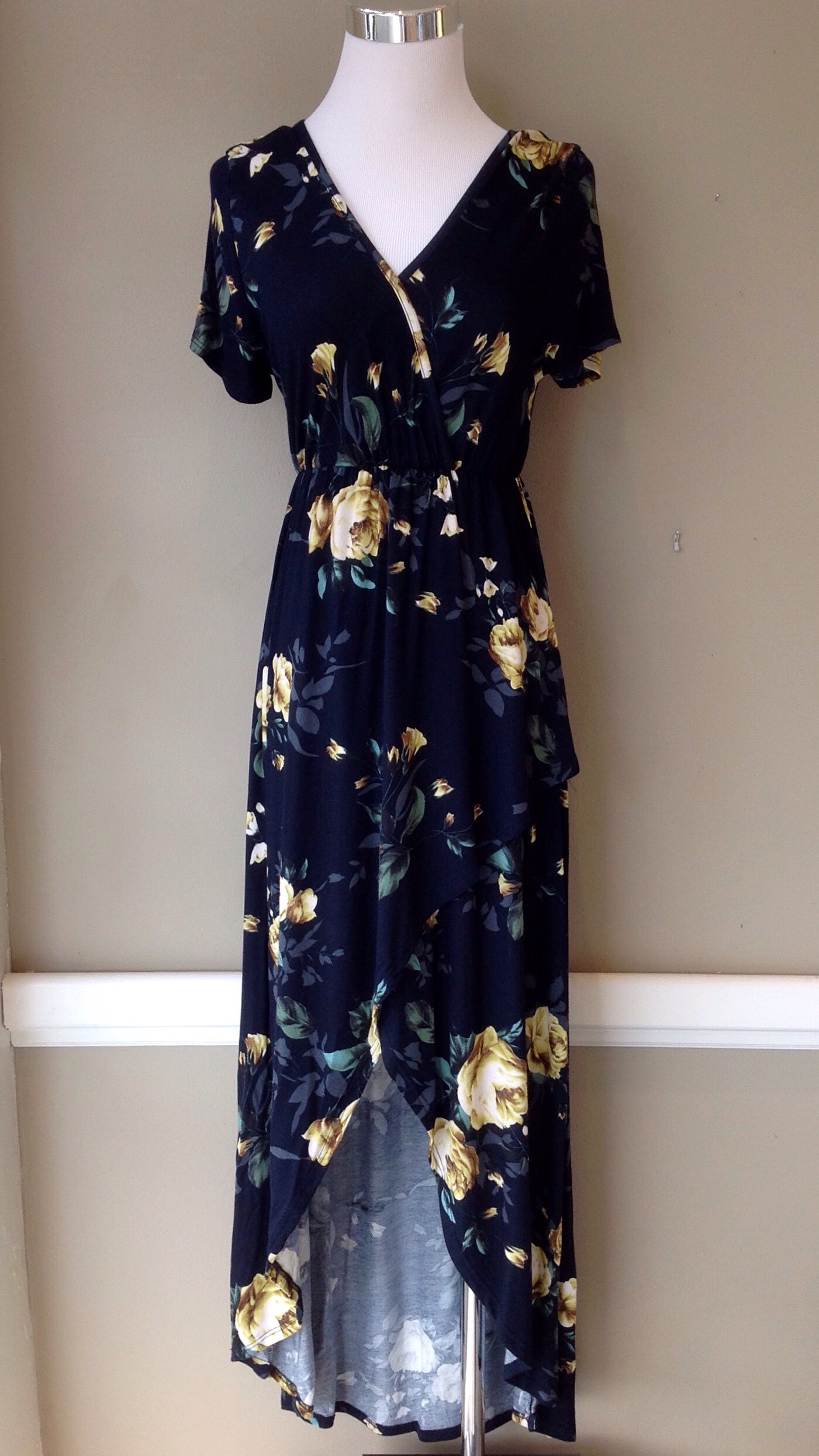 Short sleeve floral maxi dress with high-low hem in navy multi, $45