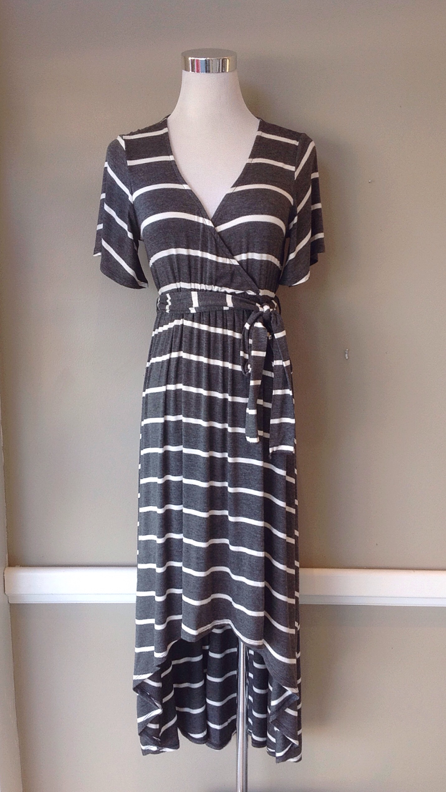 Knit maxi dress with high-low hem and waist tie in grey and off-white stripe, $42