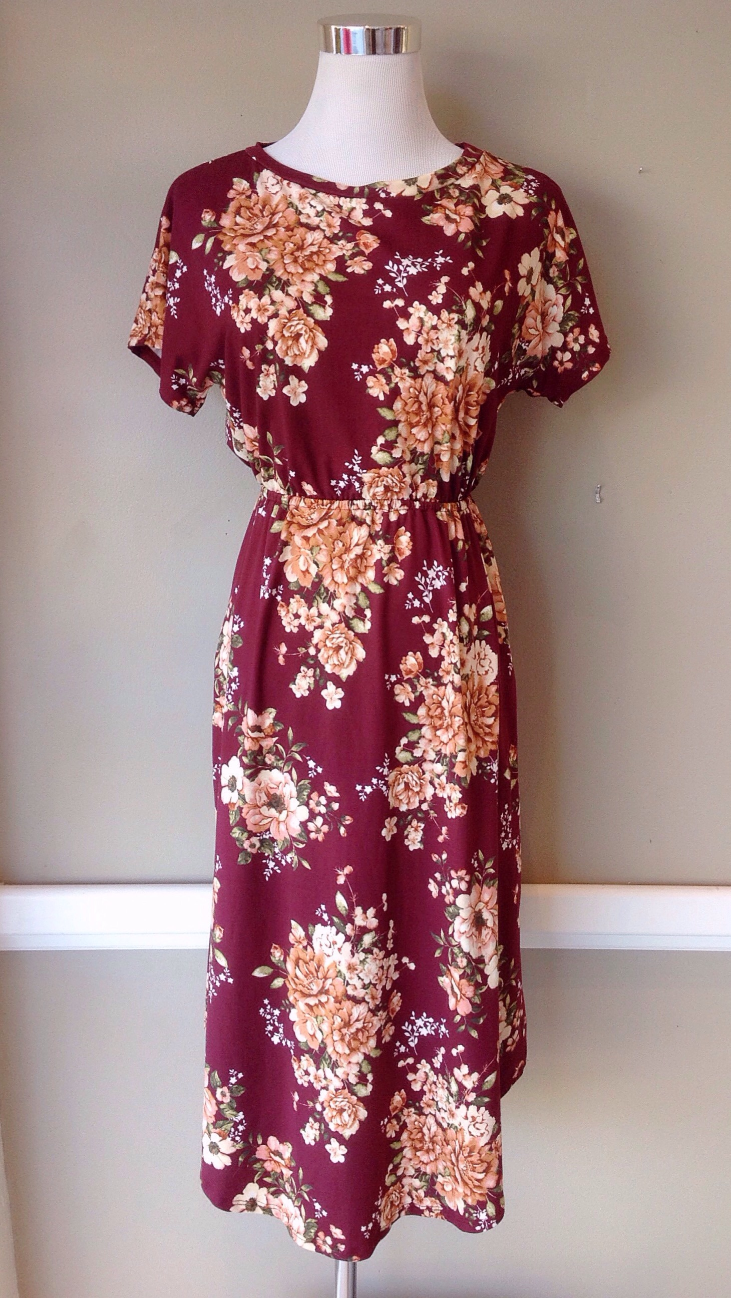 Soft floral midi dress with gathered waist in burgundy, $38