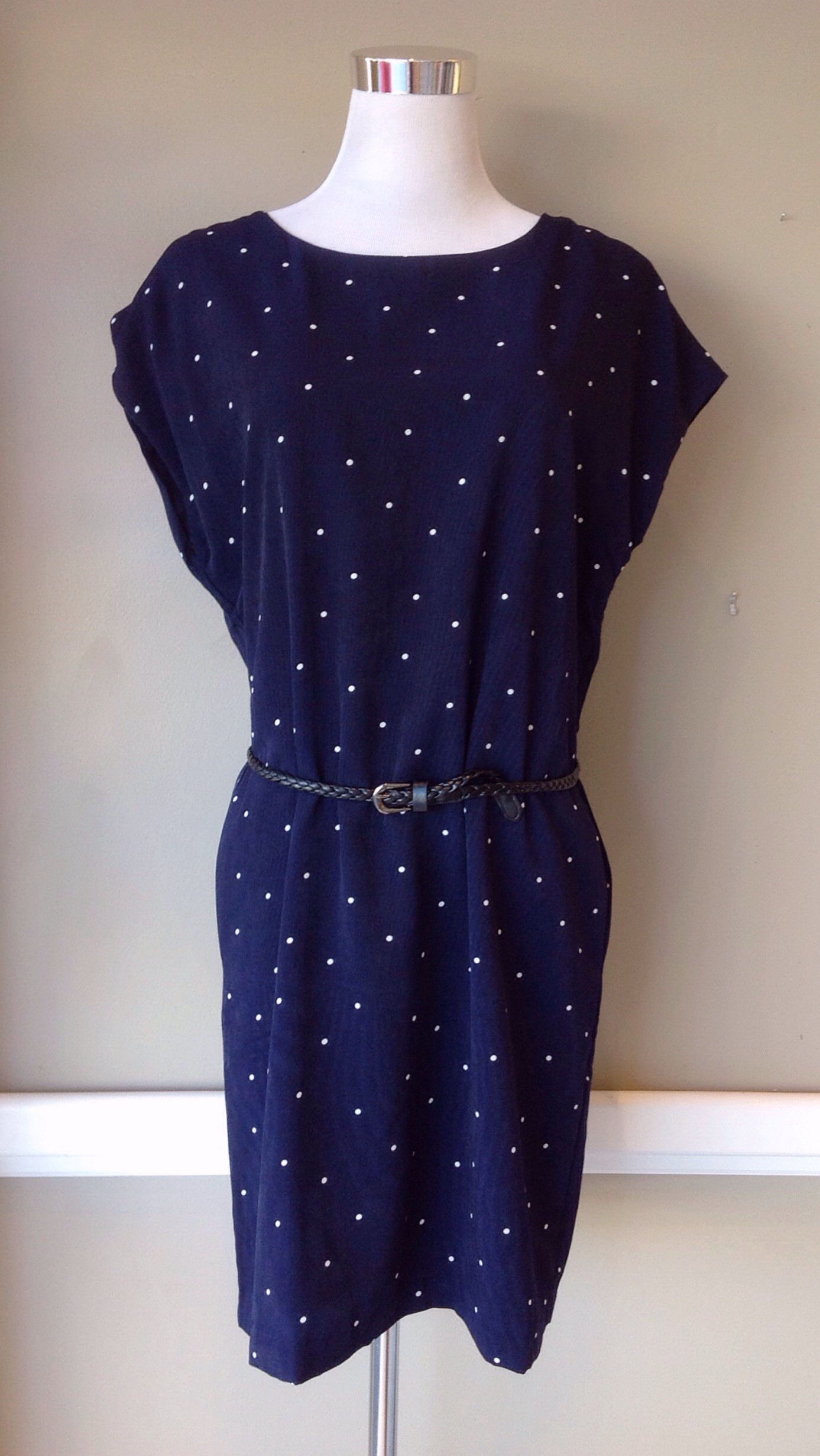 Navy and white polka dot shift dress with removable belt and side pockets, $42