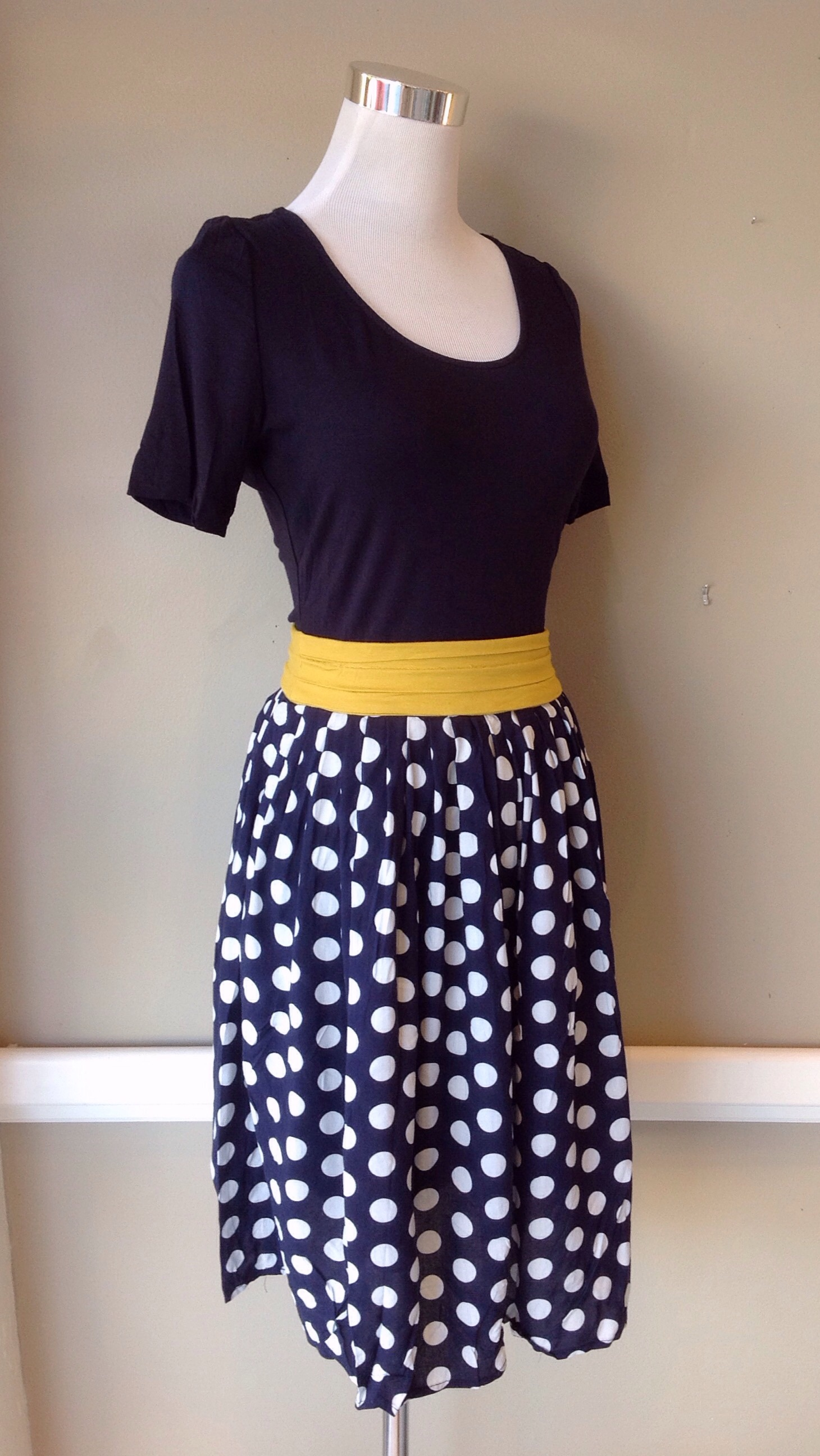 Dark navy dress with knit bodice and contrasting mustard belt, $42