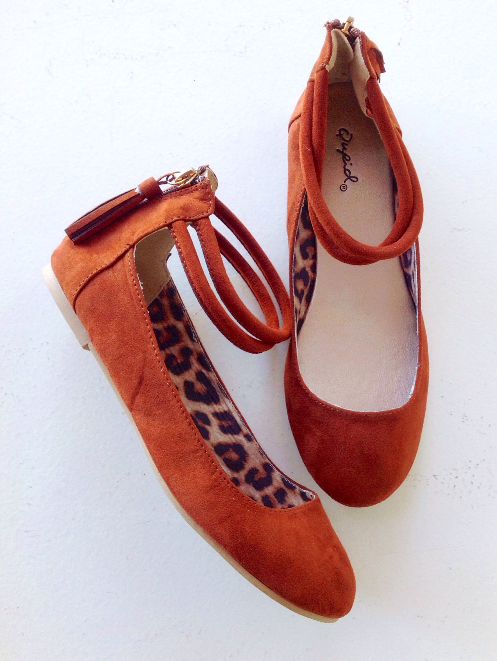 Faus suede ballet flats with ankle straps and back tasseled zippers in whiskey, $28