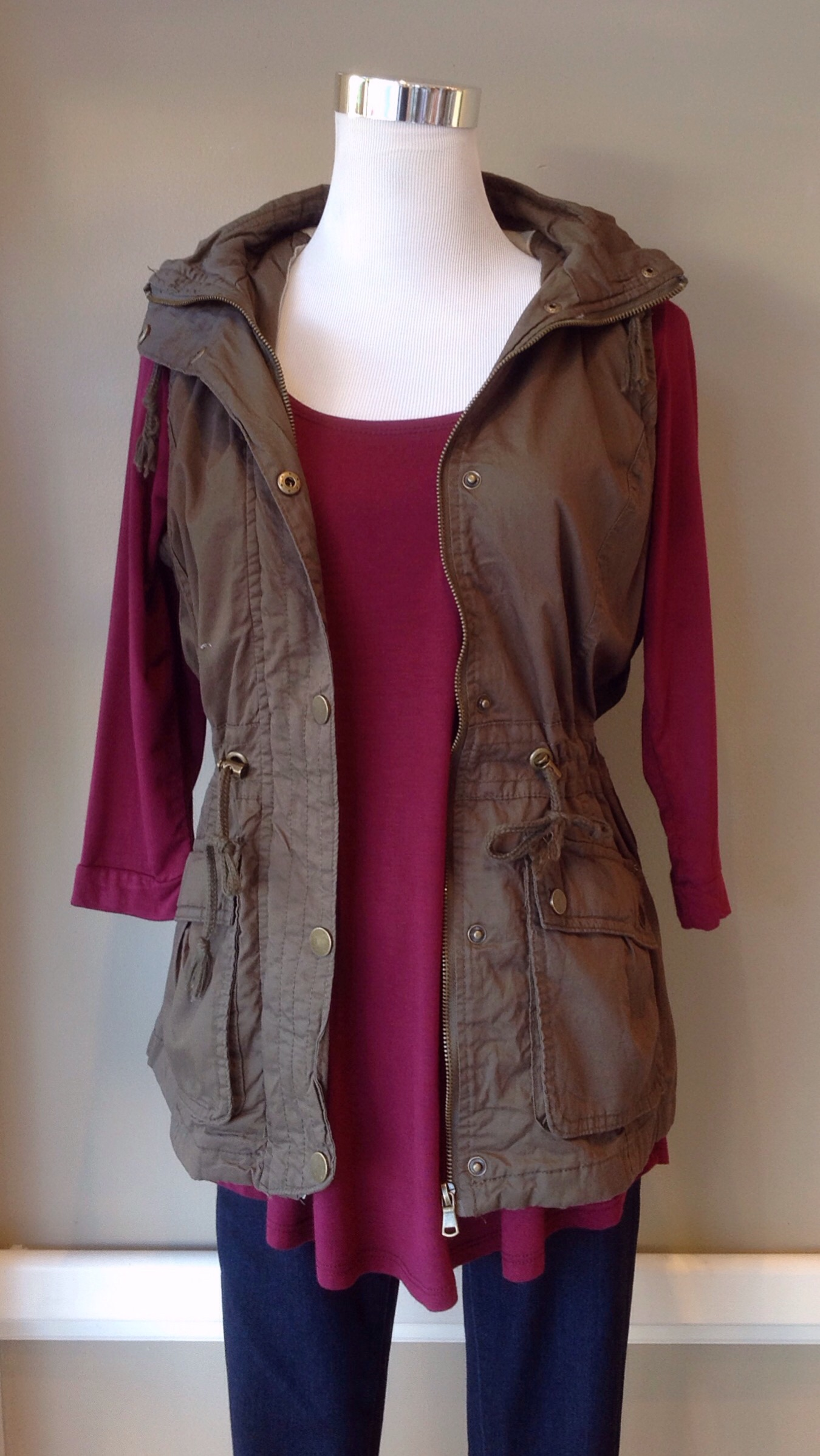 Olive field vest with drawstring waist and removable hood, $45