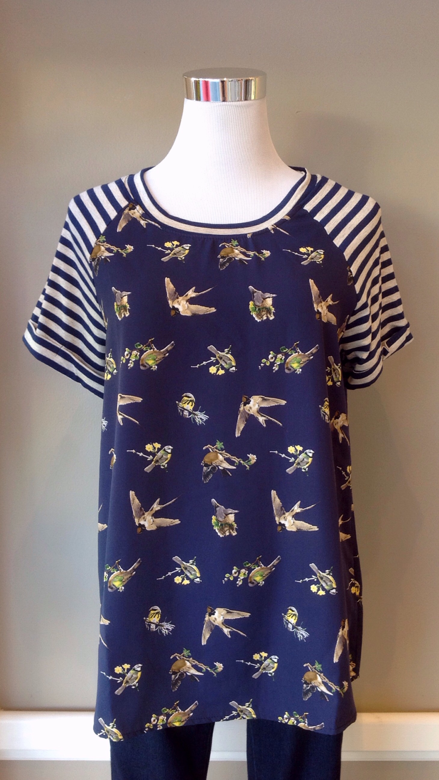 Woven bird print tee with contrasting knit sleeve, $32