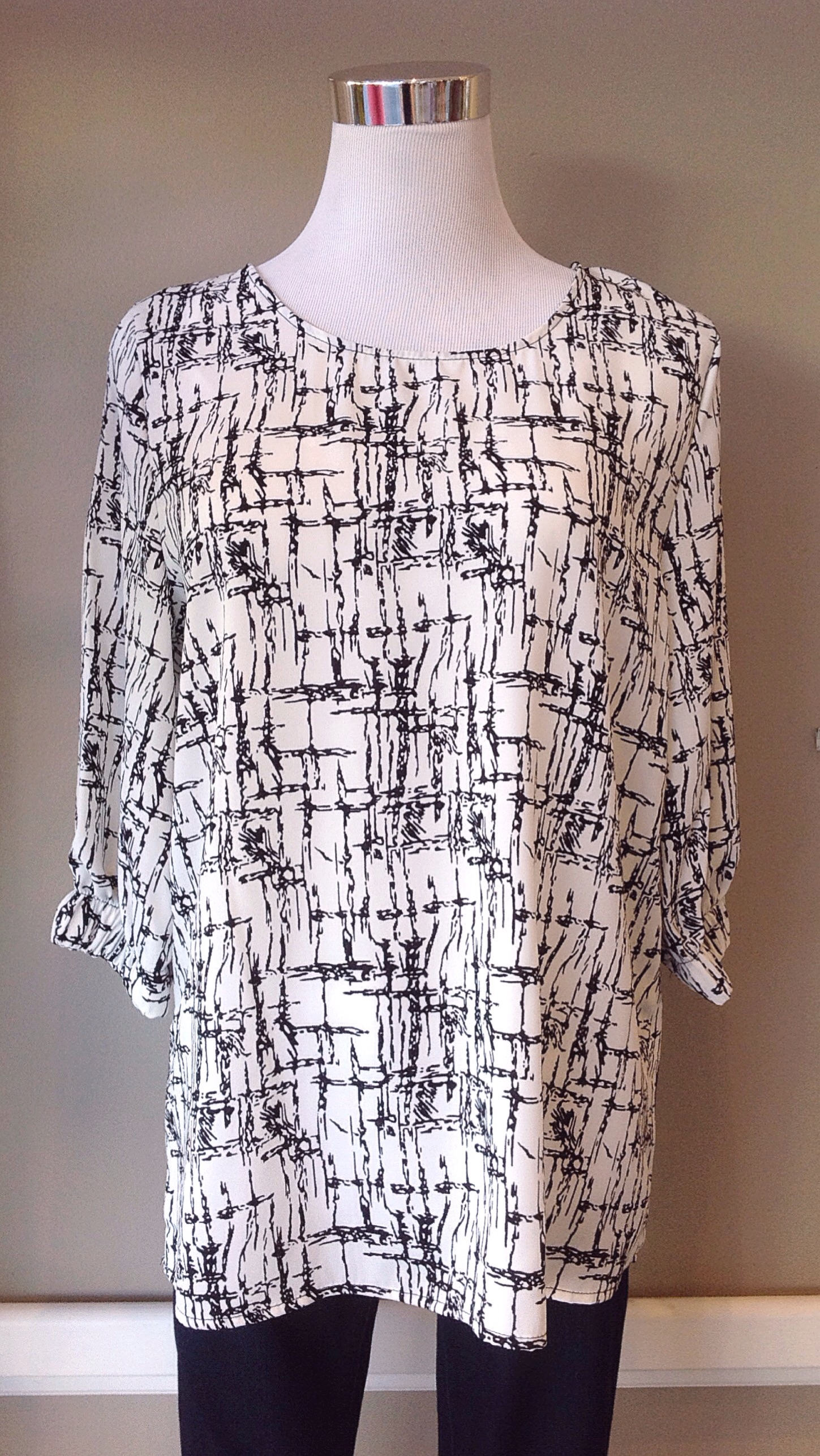 Black and ivory woven print blouse, $34