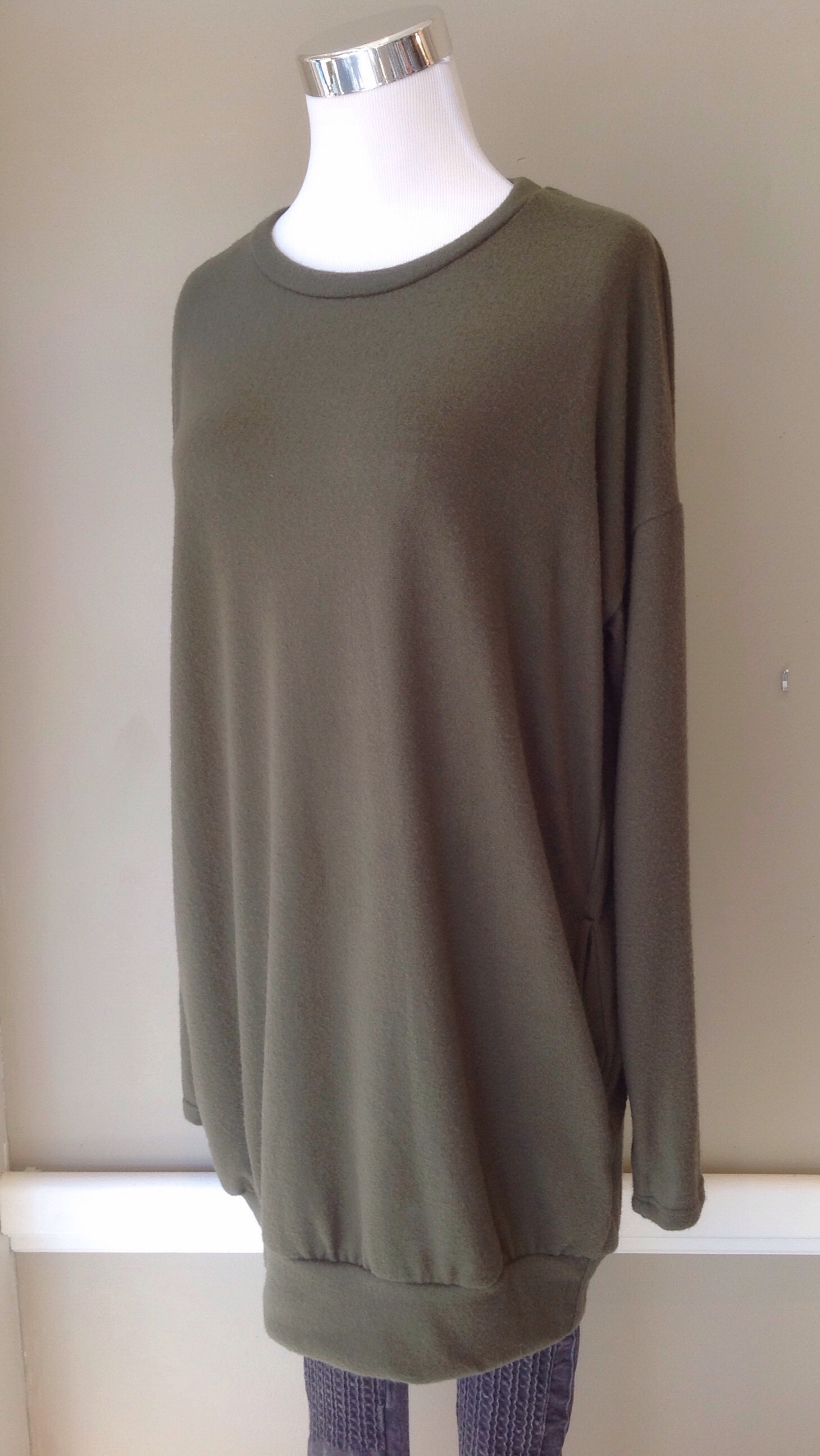 Cherish soft knit sweater with side pockets in olive, $34