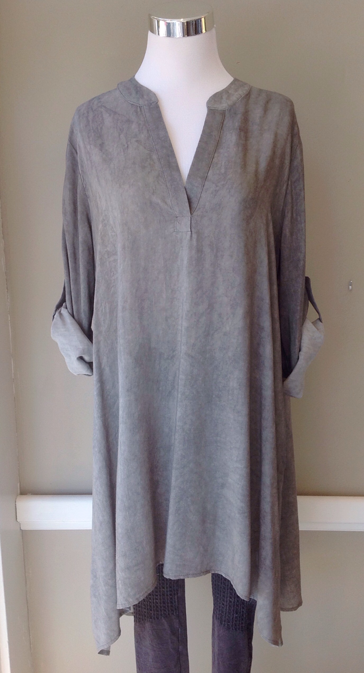 Rayon woven tunic with handkerchief hem and roll tab sleeves, $38