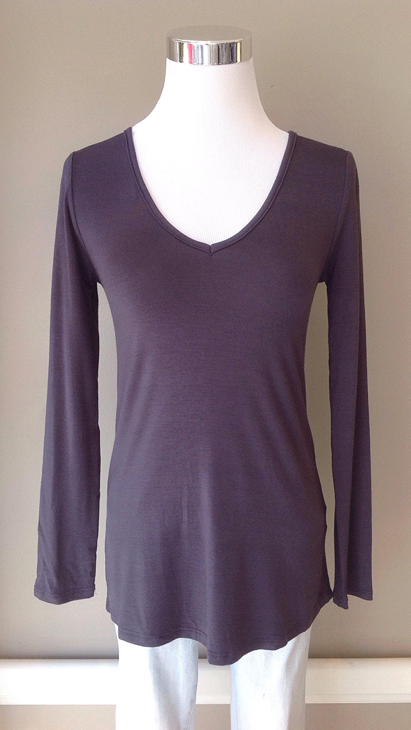 Charcoal v-neck jersey knit top, $26. Also available in warm grey.