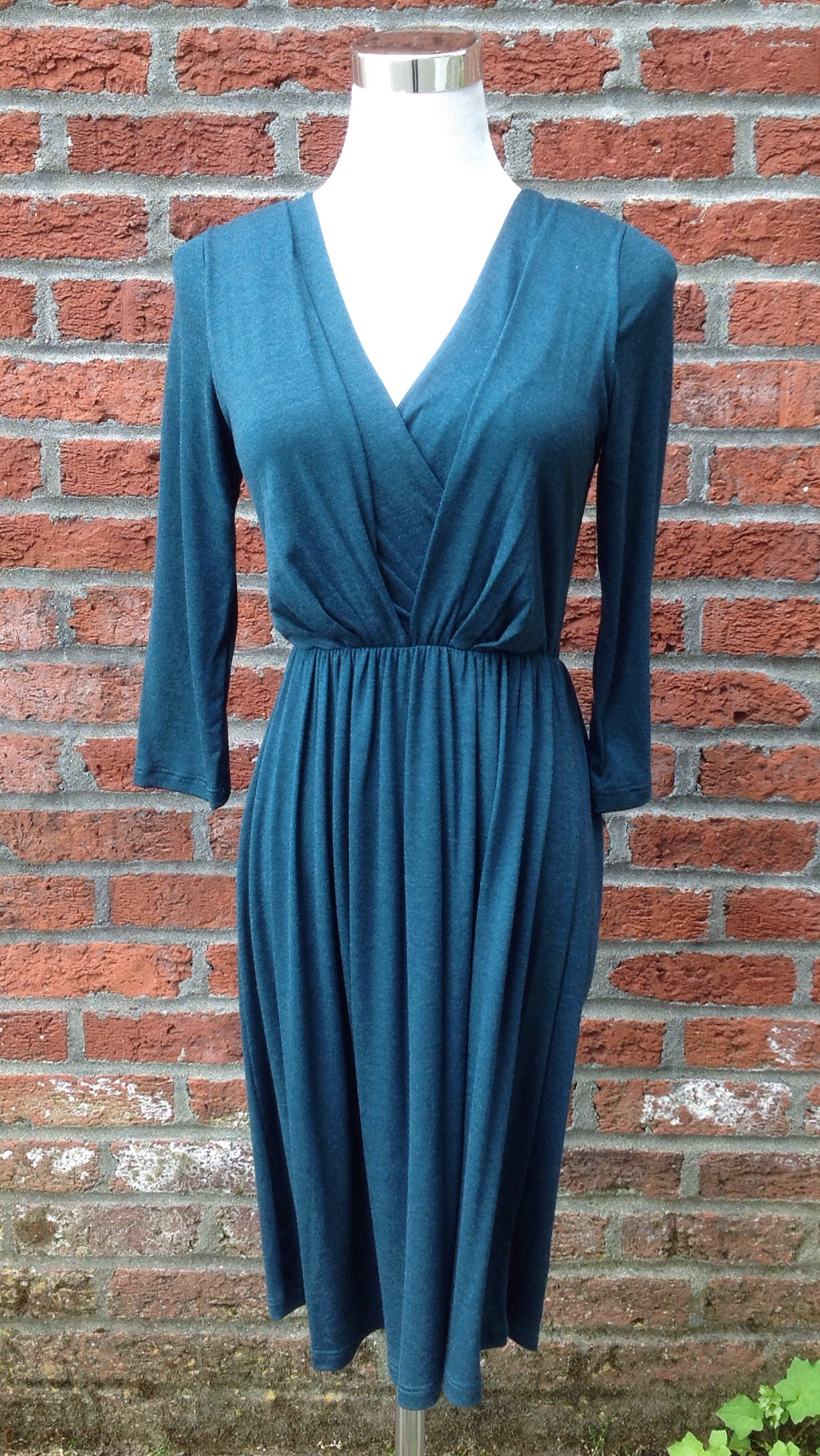 Teal knit dress with front pleats and gathered waist