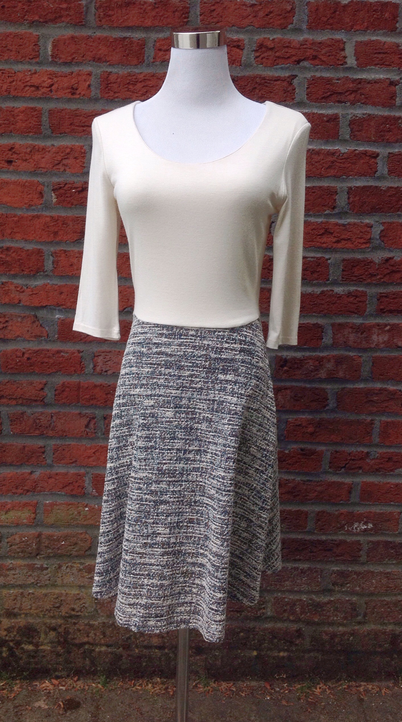 Scoop neck knit dress with contrasting textured skirt in ivory/grey