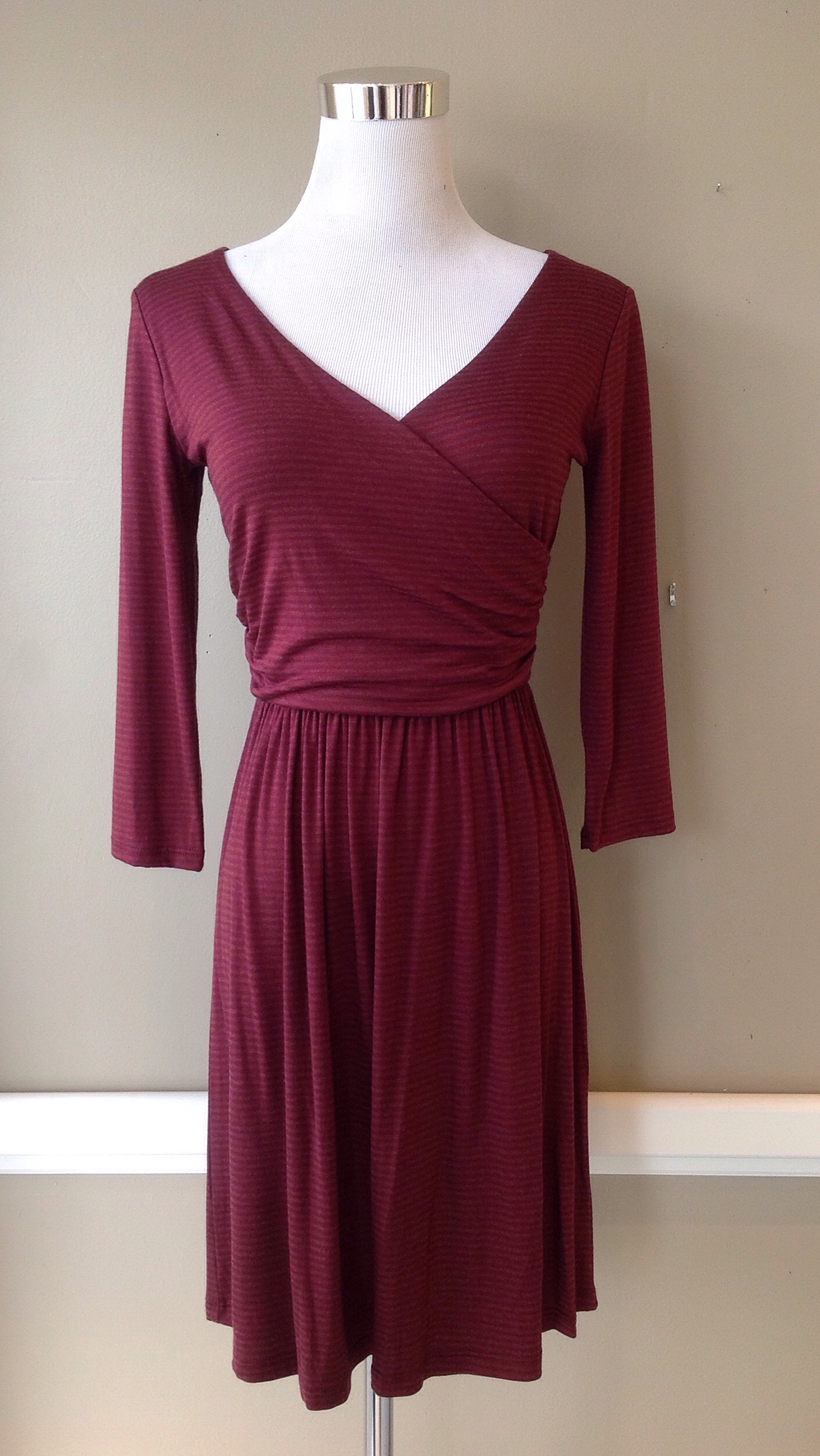 Subtle stripe, wrap-style dress in burgundy