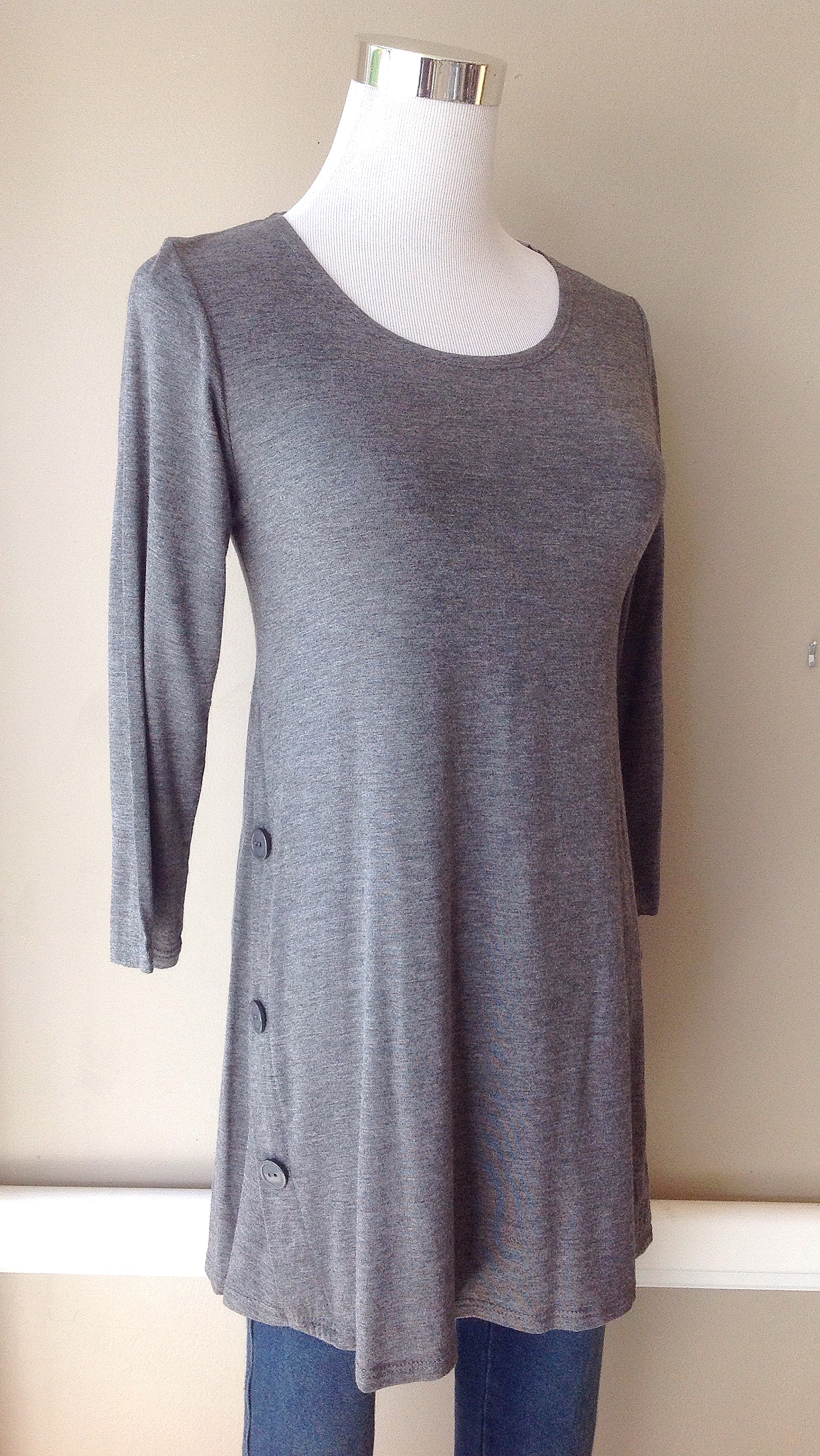 Heather grey tunic top with side button detail and 3/4 sleeves, $34