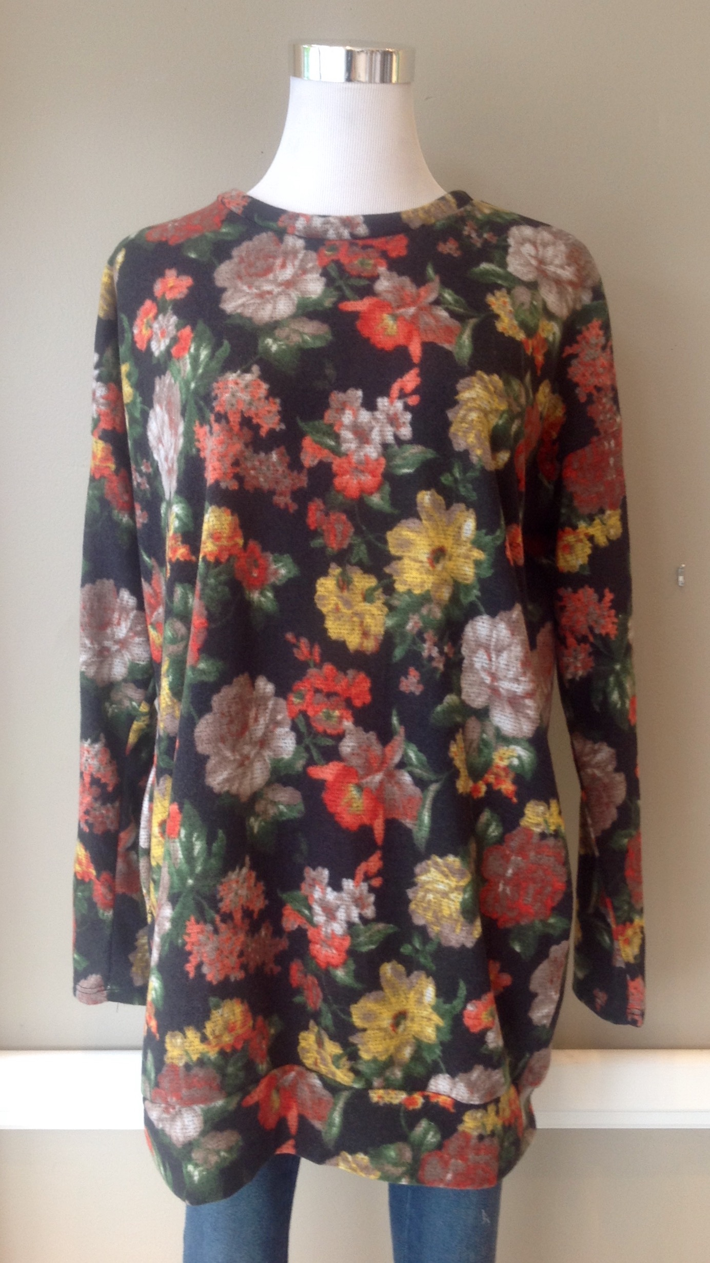 Fleecy tunic sweater with side pockets in multicolored floral, $35