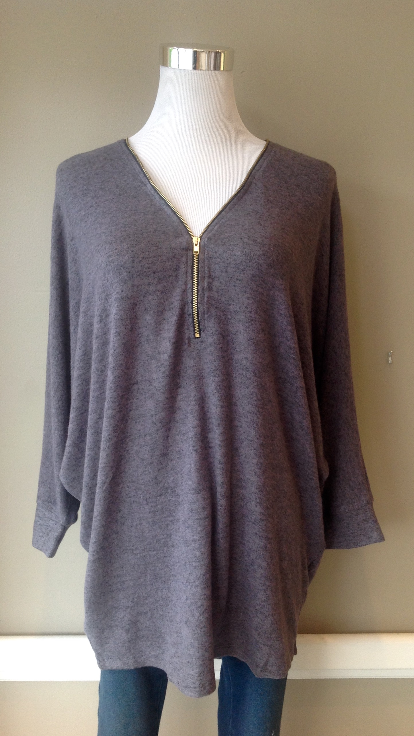 Zip front, fleecy knit sweater with batwing sleeves, $35. Also available in heather grey.