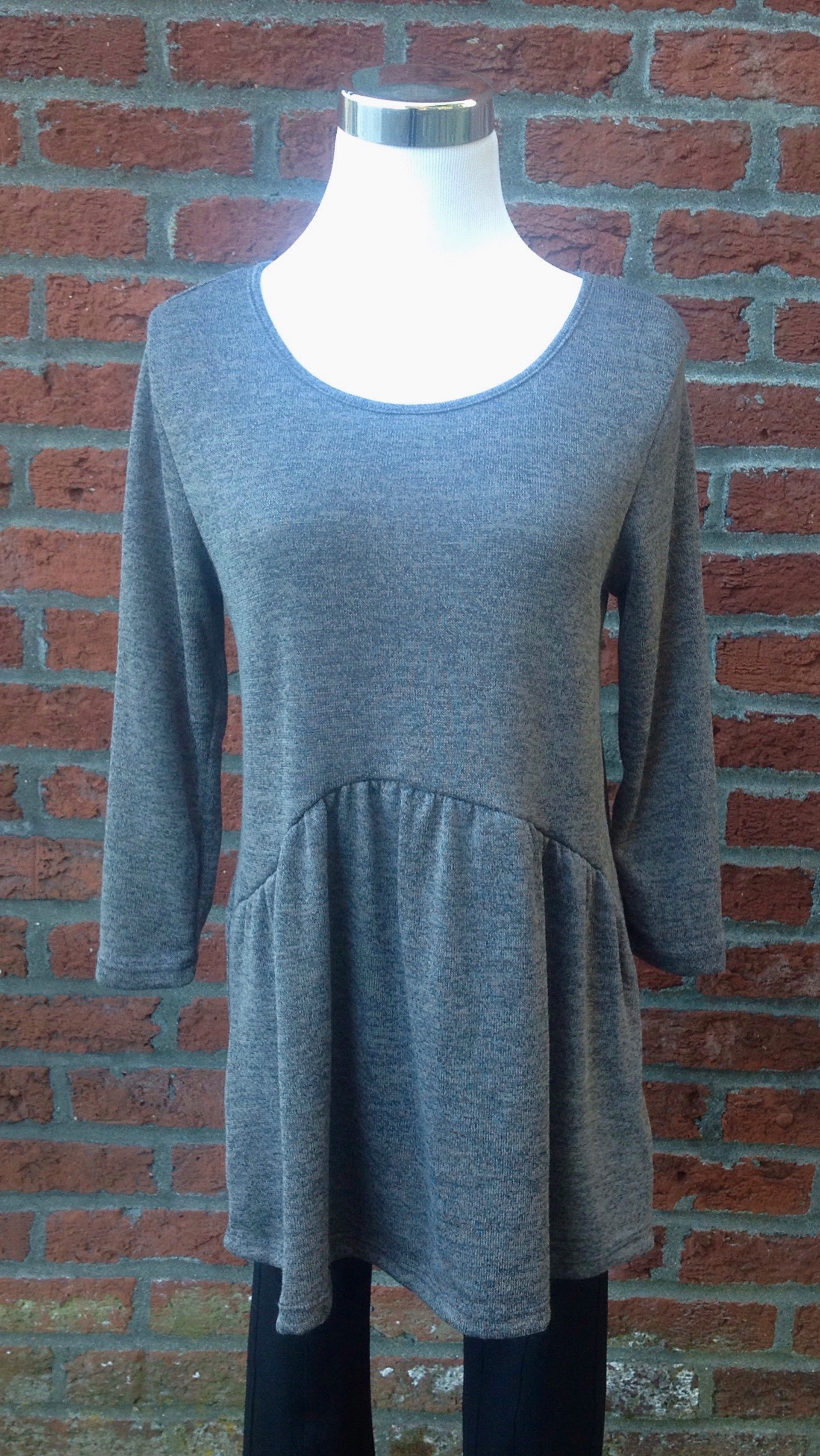 Charcoal sweater with 3/4 sleeves and gathered, asymmetrical waistline, $32