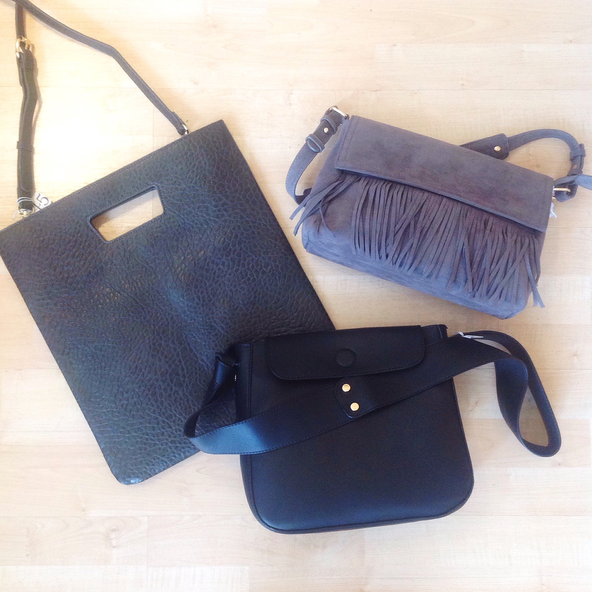 Assorted faux leather handbags from $42