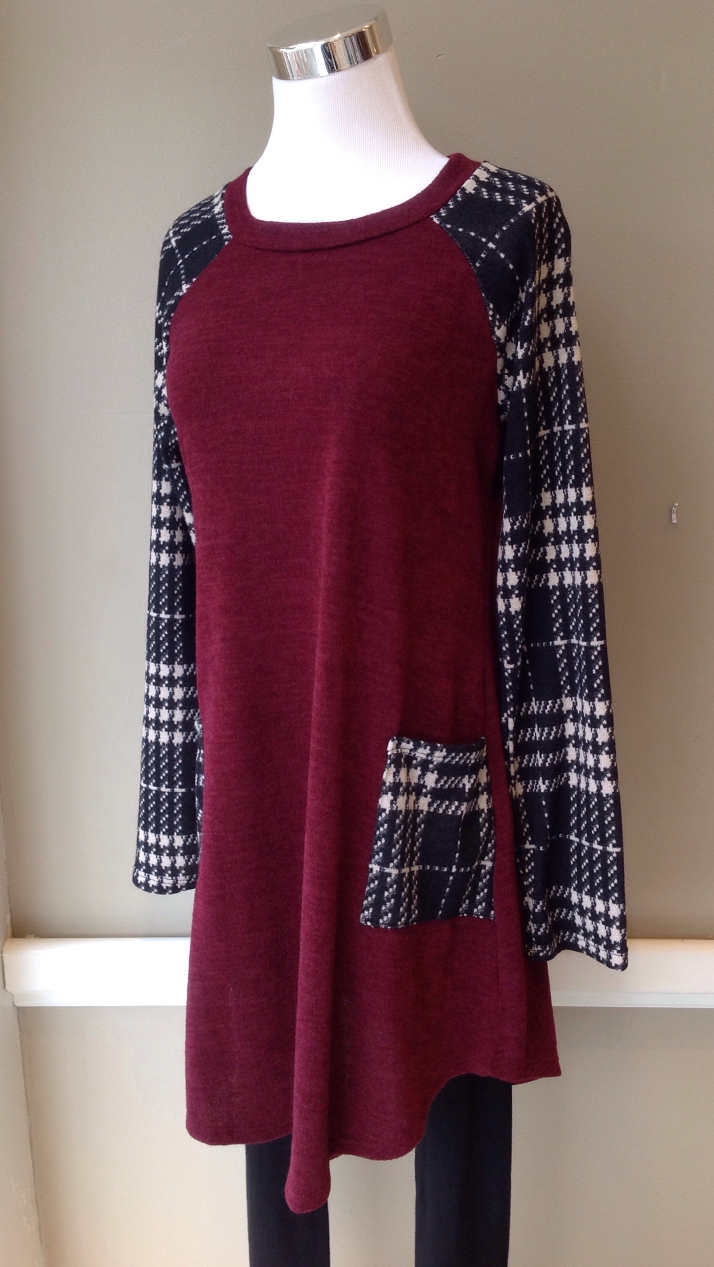 Sweater knit tunic with patch pockets in wine/black plaid, $38