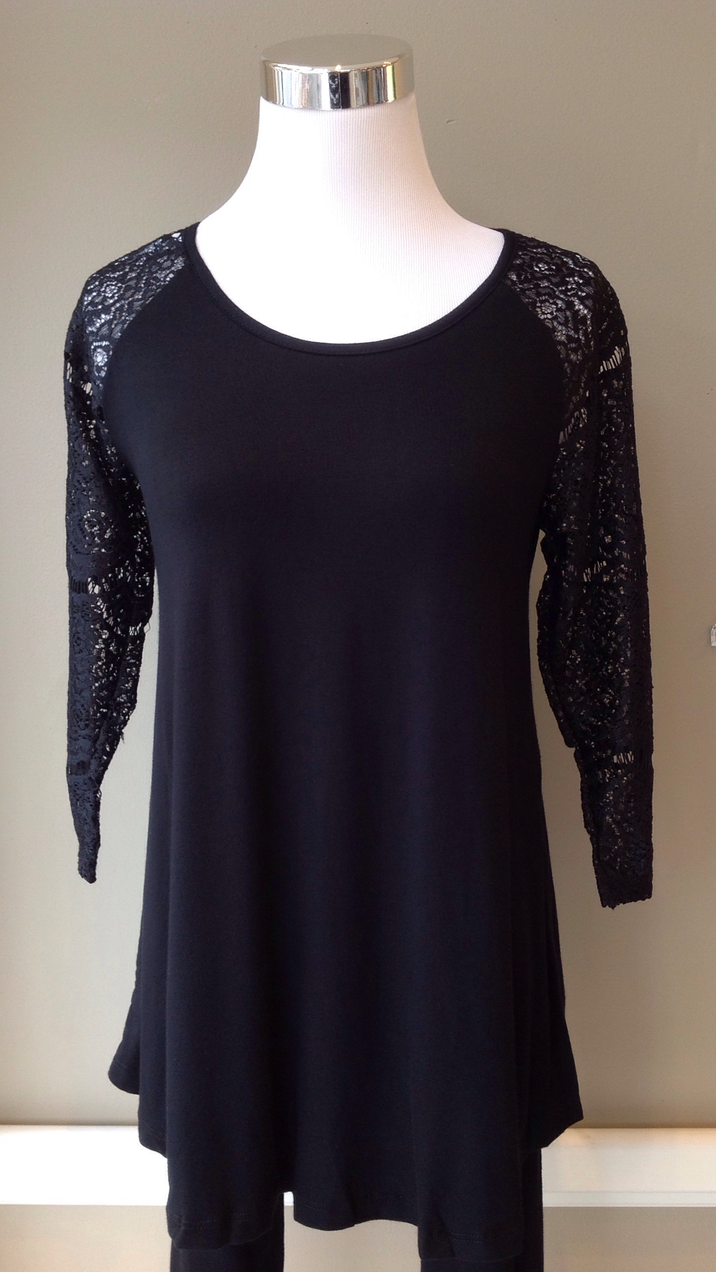Black jersey knit top with 3/4 lace sleeves, $34