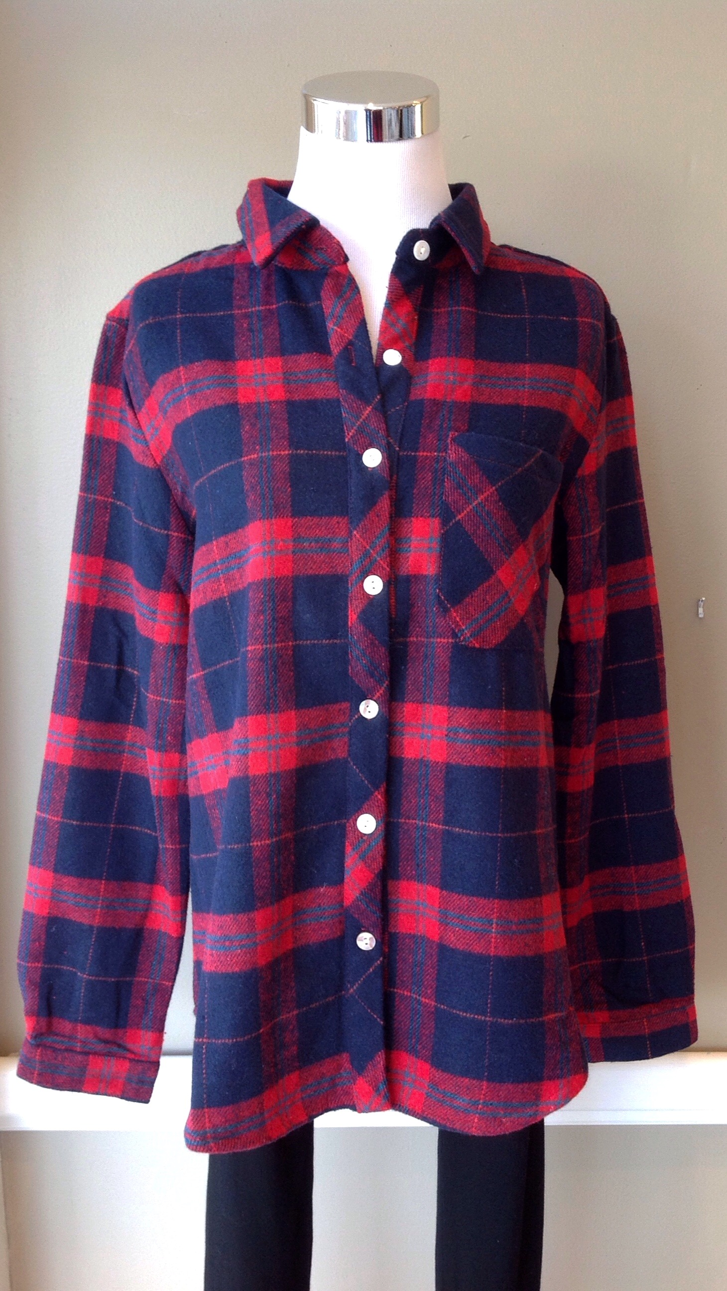 Flannel button-down in red/navy, $34