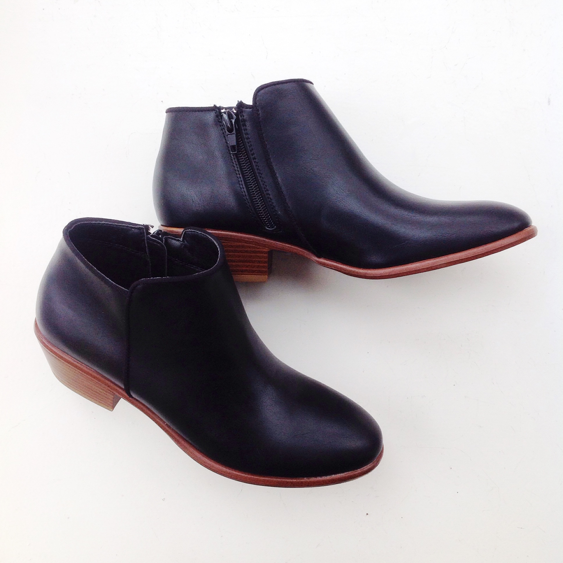 Sleek faux leather booties in black, $45