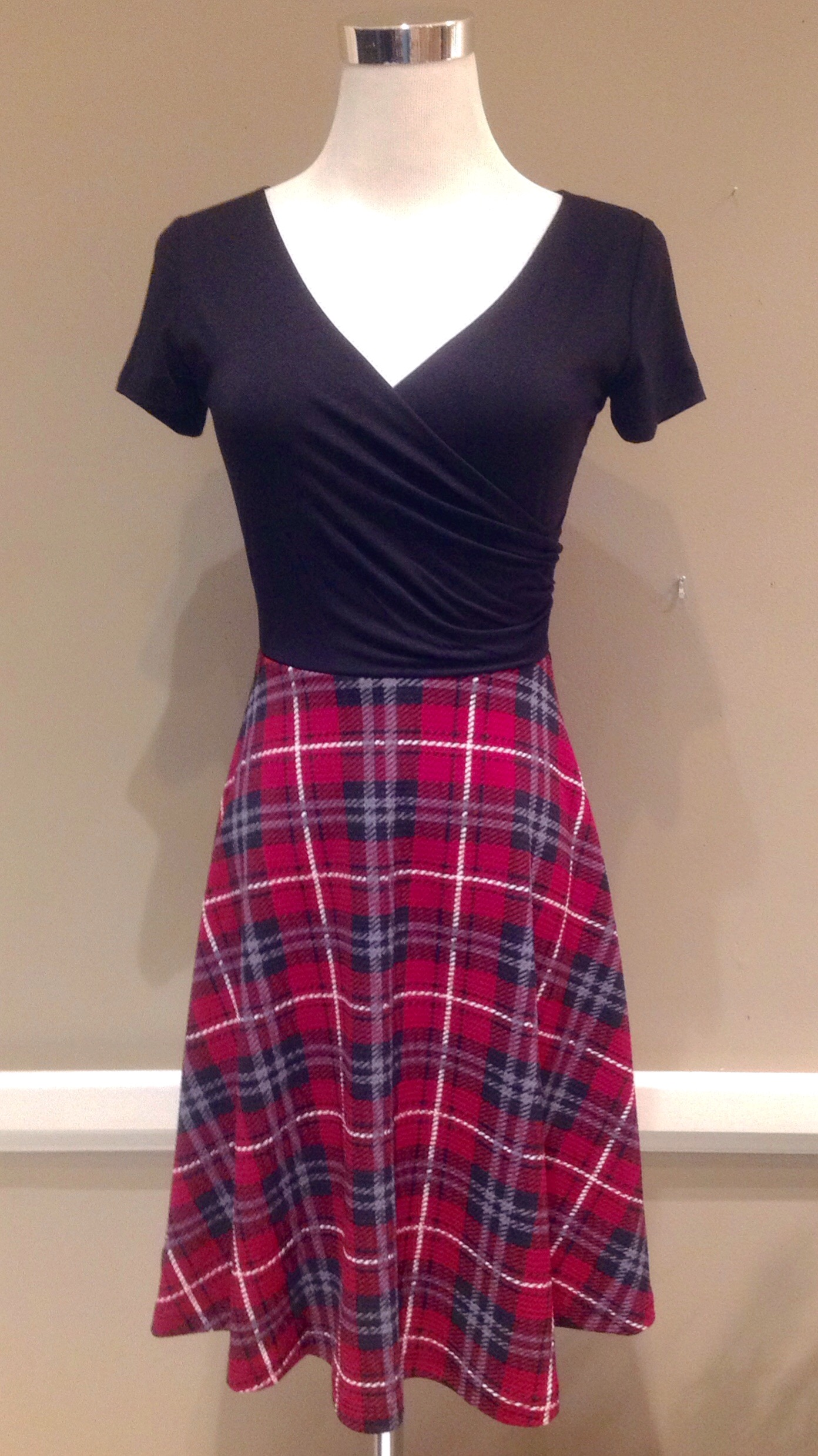 Knit wrap front dress with A-line skirt in black/red plaid,  $42
