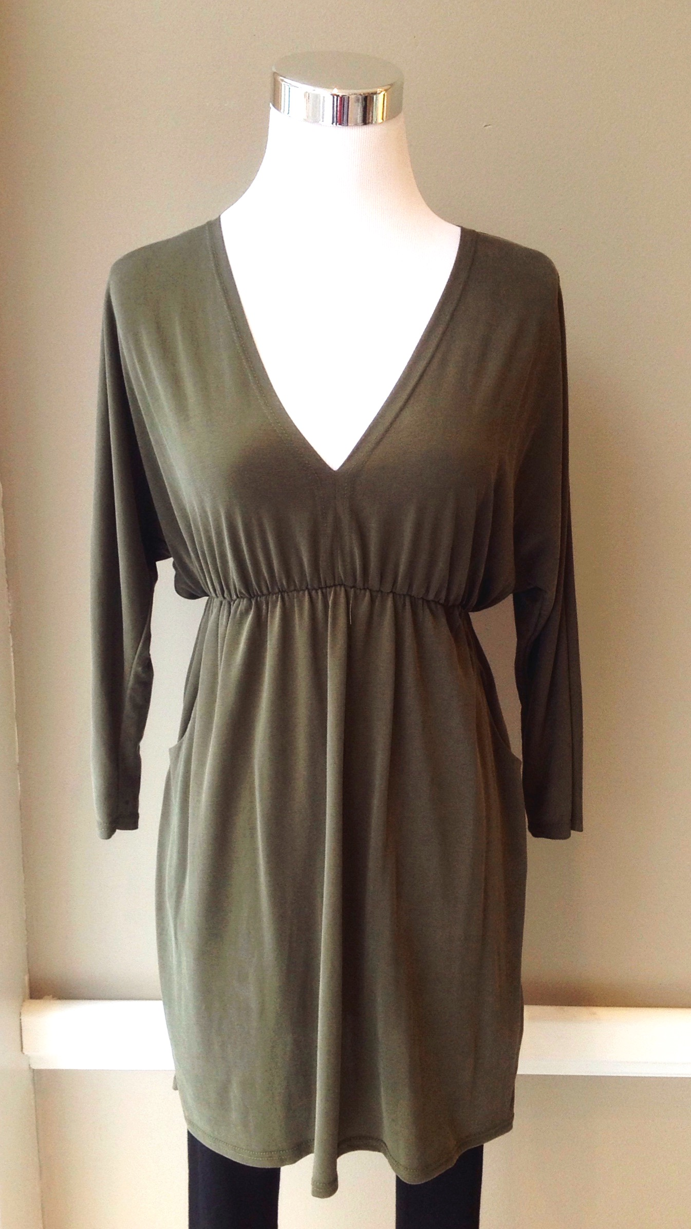 Woven tunic with gathered empire waist and side pockets in olive, $35