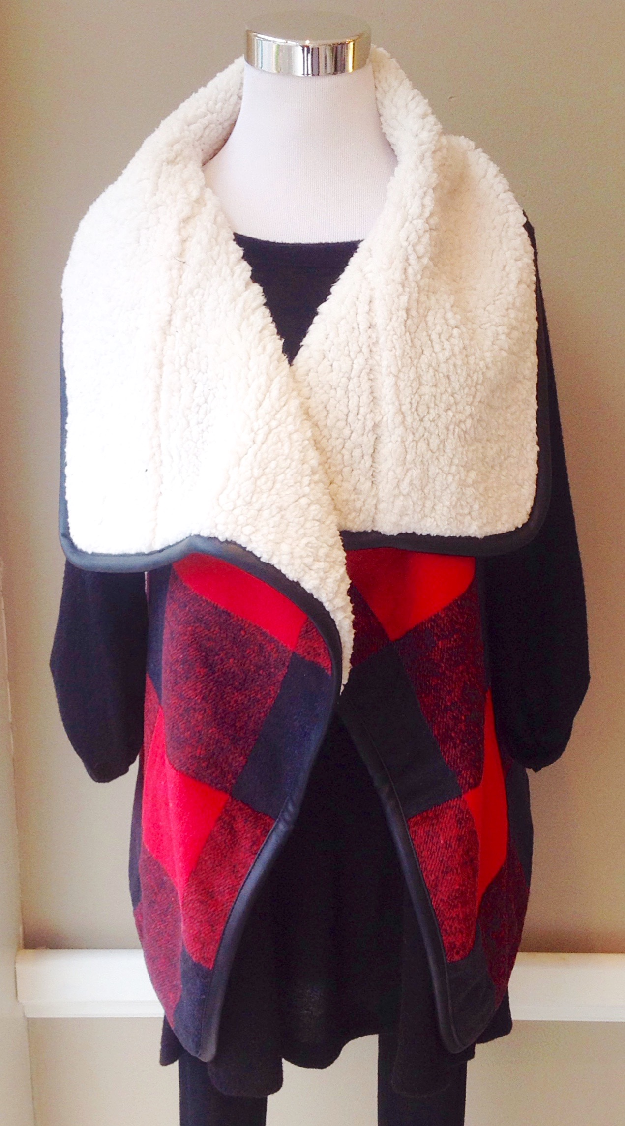 Buffalo check vest with faux shearling shawl collar, side pockets and faux leather trim, $45
